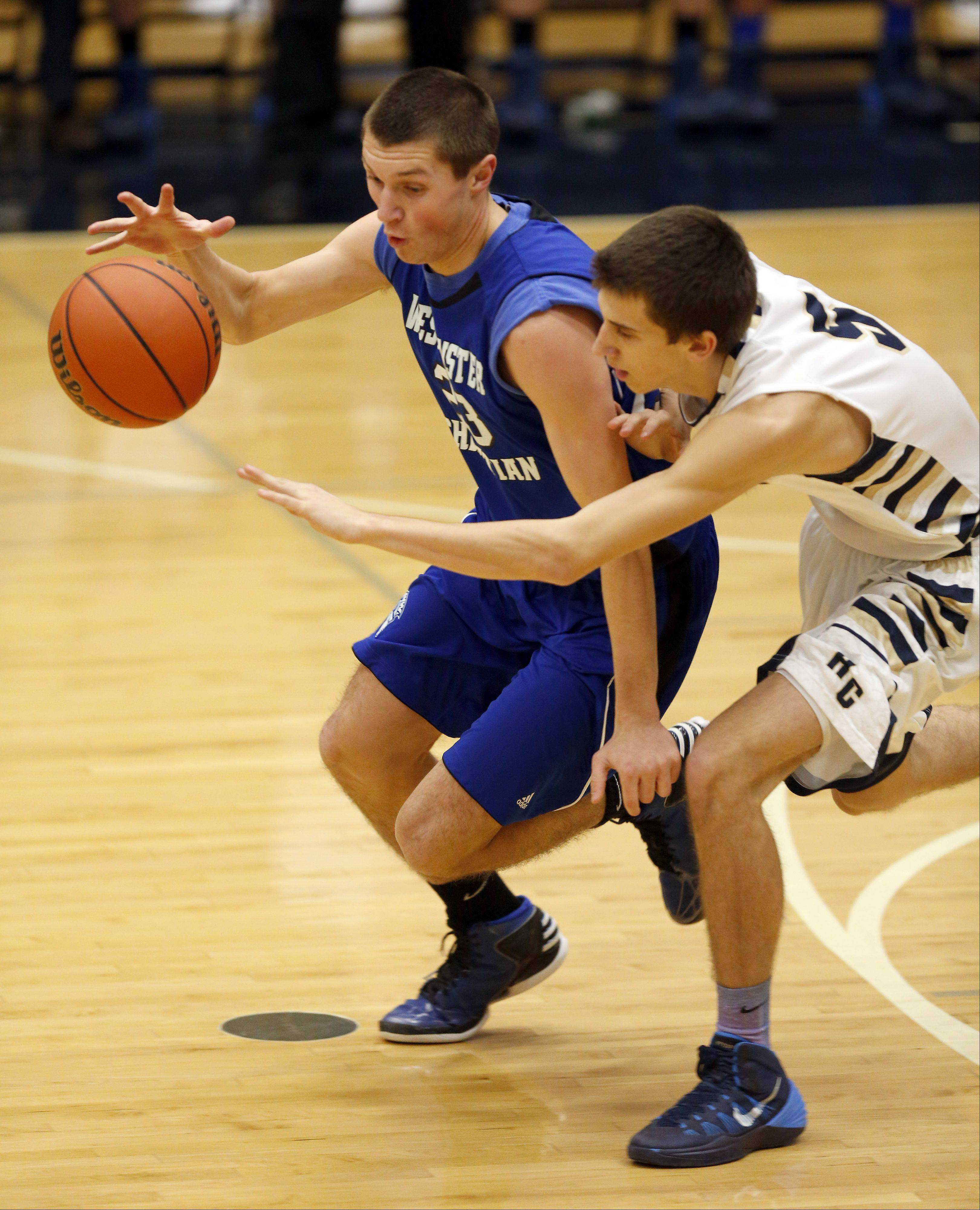 Westminster Christian�s Robert Kleczynski works past Harvest Christian�s Brett Cramer Friday in Elgin.