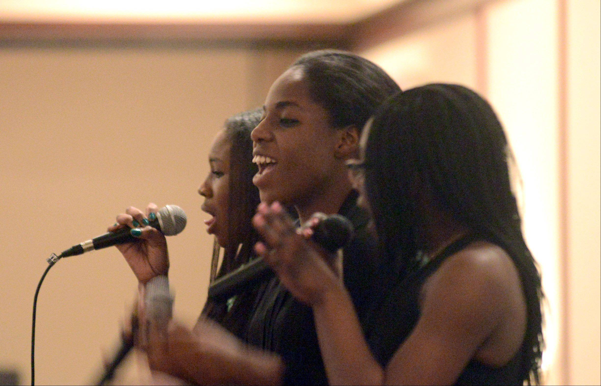 The musical group Cherished Praize performs Friday during the 13th annual Dr. Martin Luther King, Jr. Remembrance and Celebration Dinner at the Chicago Marriott Northwest Hotel in Hoffman Estates.