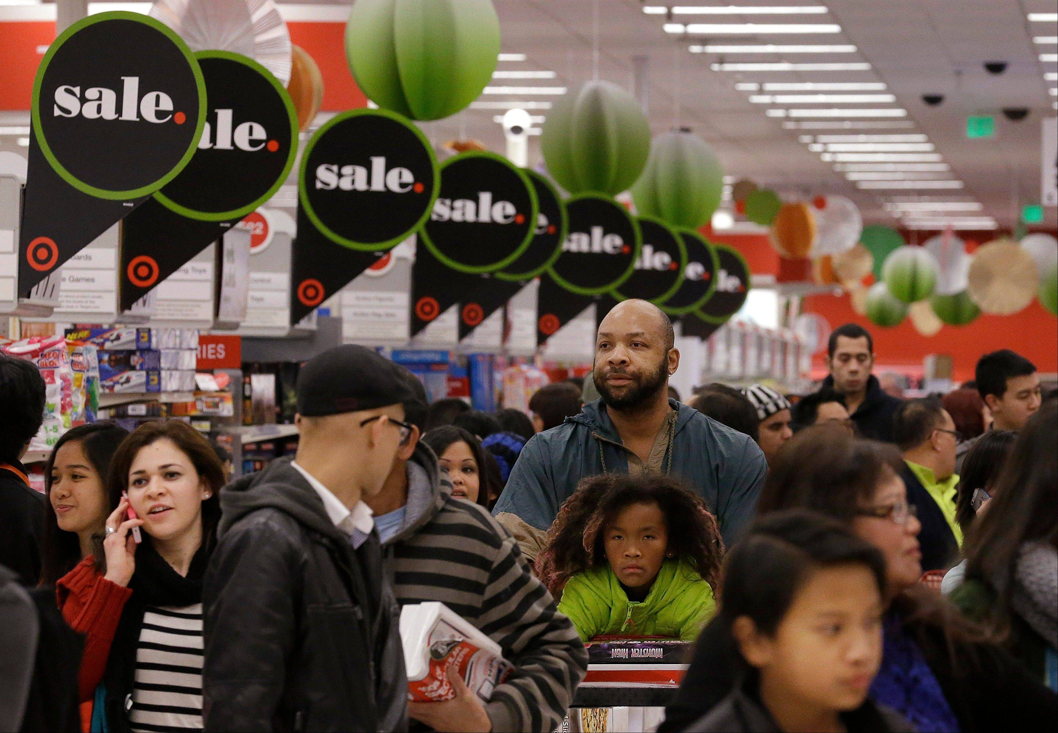 Shoppers at a Target store in Colma, Calif. The retail giant wasn't the only company to get hit with a data breach over the holidays. Last week, Neiman Marcus said thieves stole some of its customers' payment information and made unauthorized charges over the holidays.