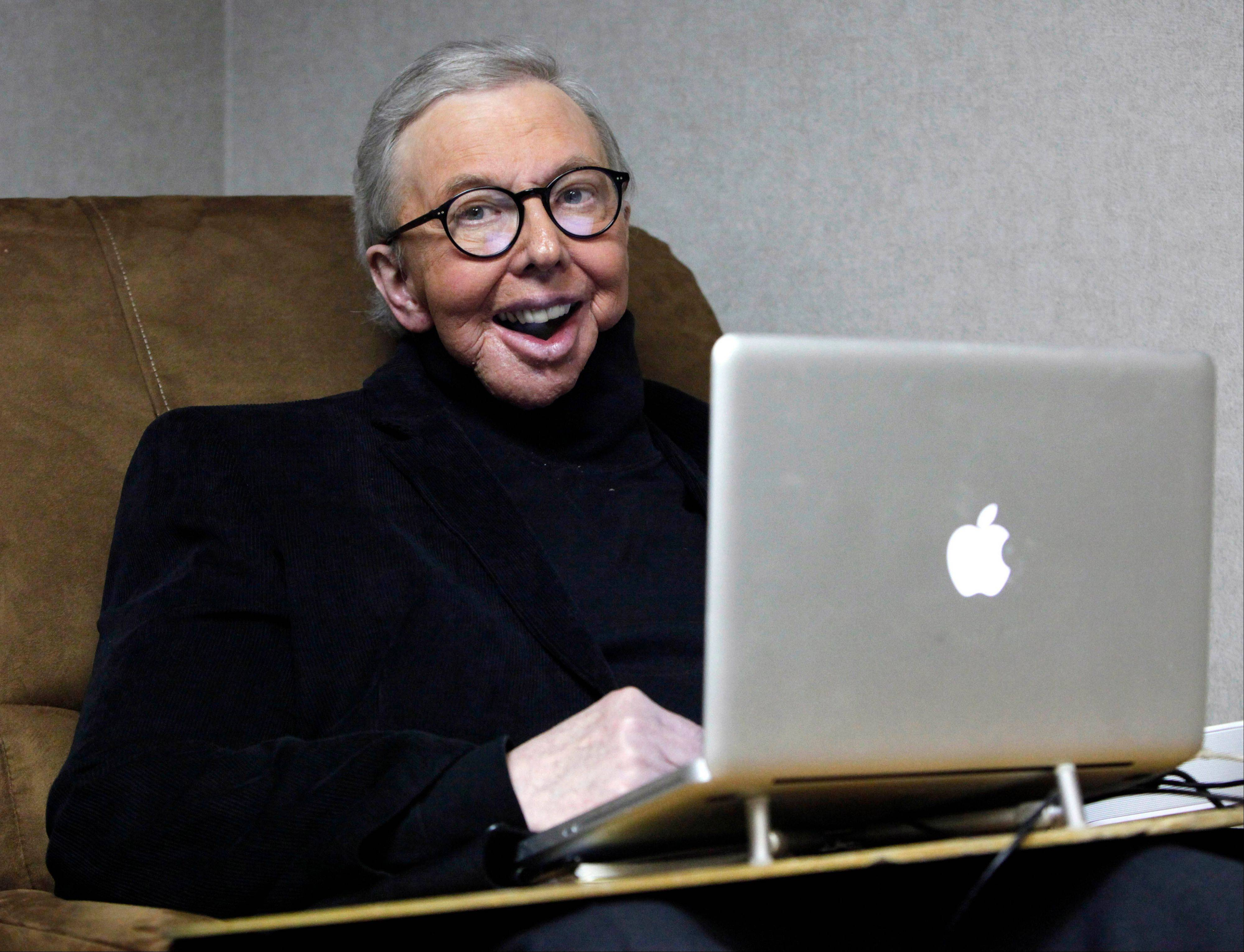 "Film critic Roger Ebert works in his office at the WTTW-TV studios in Chicago in 2011. When ""Life Itself"" debuts Sunday at the Sundance Film Festival, it will be the first time Ebert's wife, Chaz, will see the full documentary about her late husband's life."