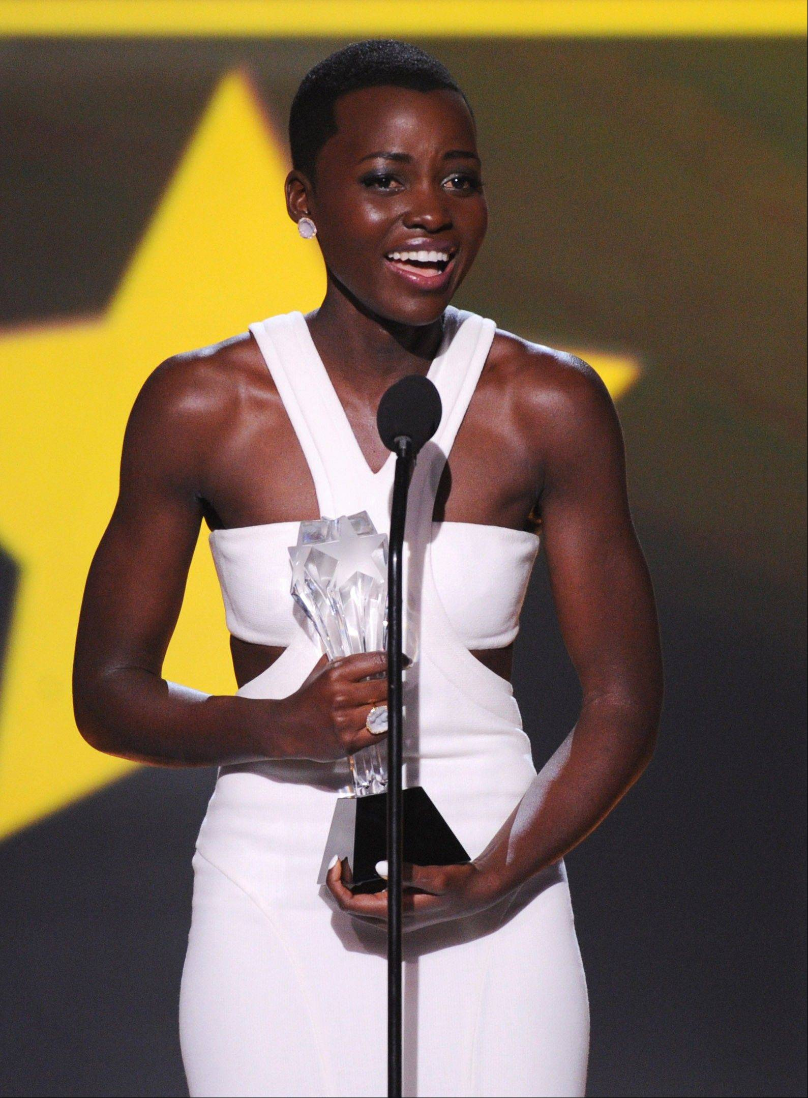 "Lupita Nyong'o accepts the award for best supporting actress for ""12 Years a Slave"" at the 19th annual Critics' Choice Movie Awards Thursday."