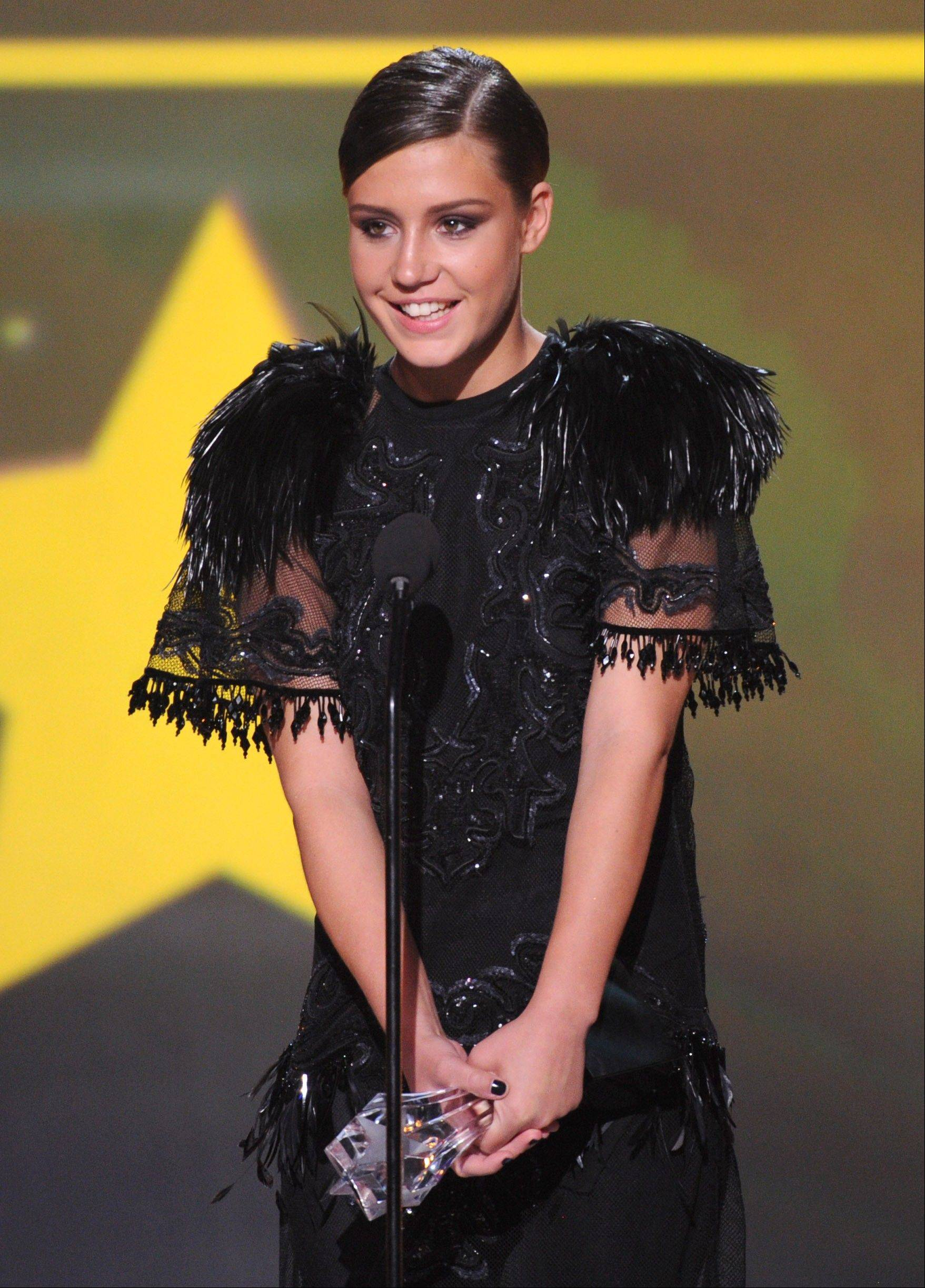 "Adele Exarchopoulos accepts the award for best young actor/actress for ""Blue is the Warmest Color"" at the 19th annual Critics' Choice Movie Awards."