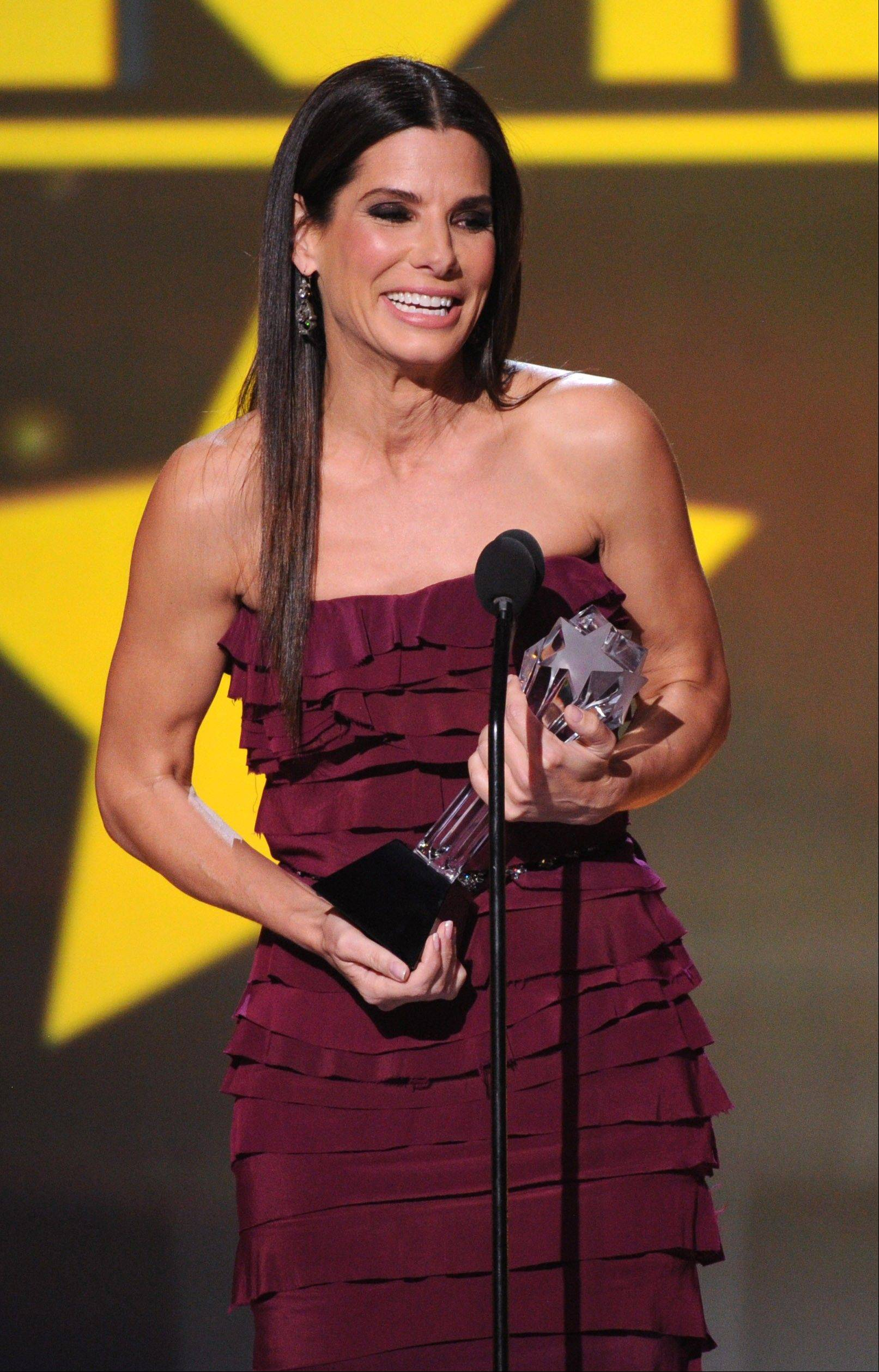 "Sandra Bullock accepts the award for best actress in an action movie for ""Gravity"" at the Critics' Choice Movie Award."