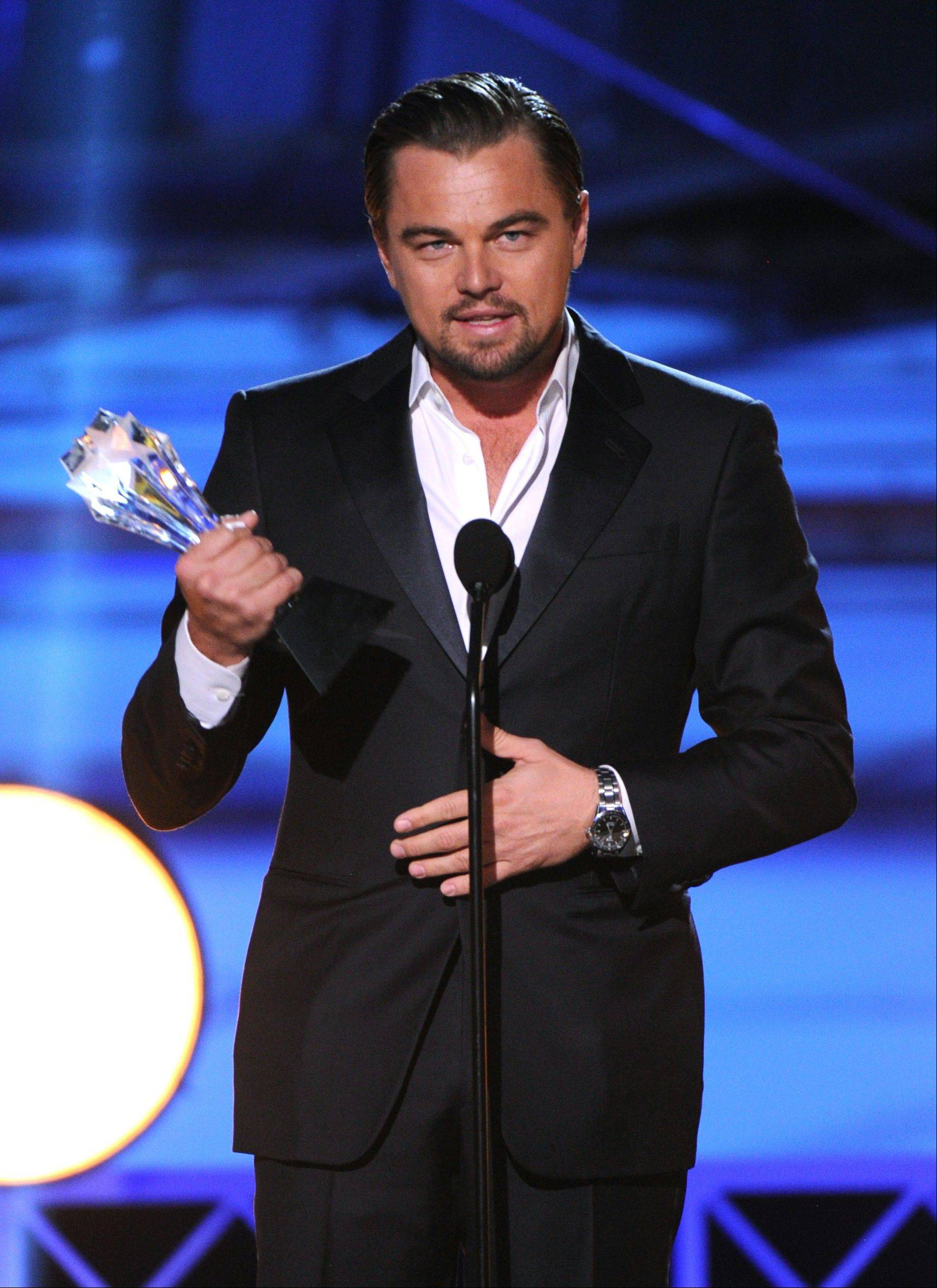 "Leonardo DiCaprio accepts the award for best actor in a comedy for ""The Wolf of Wall Street"" at the Critics' Choice Movie Awards Thursday."