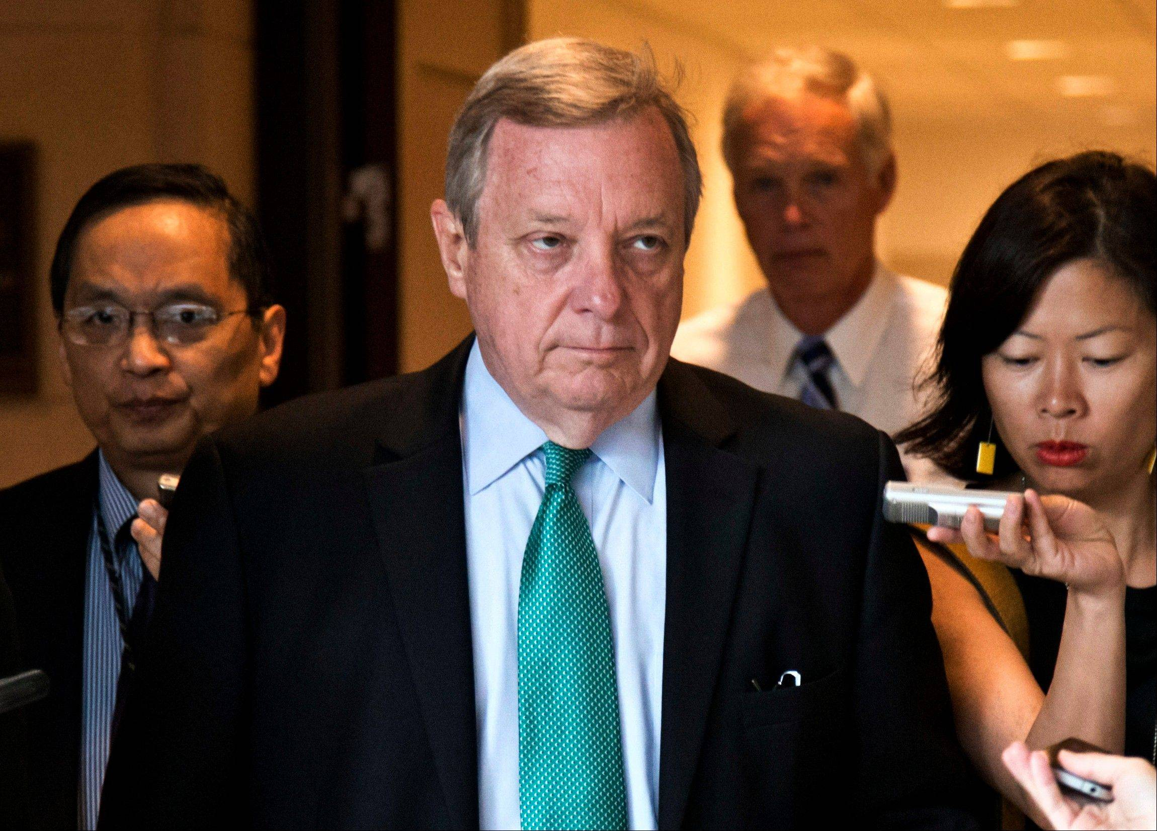 U.S, Sen. Dick Durbin said Friday that he's working with Illinois lawmakers to raise the state's minimum wage, which now is $8.25 an hour.
