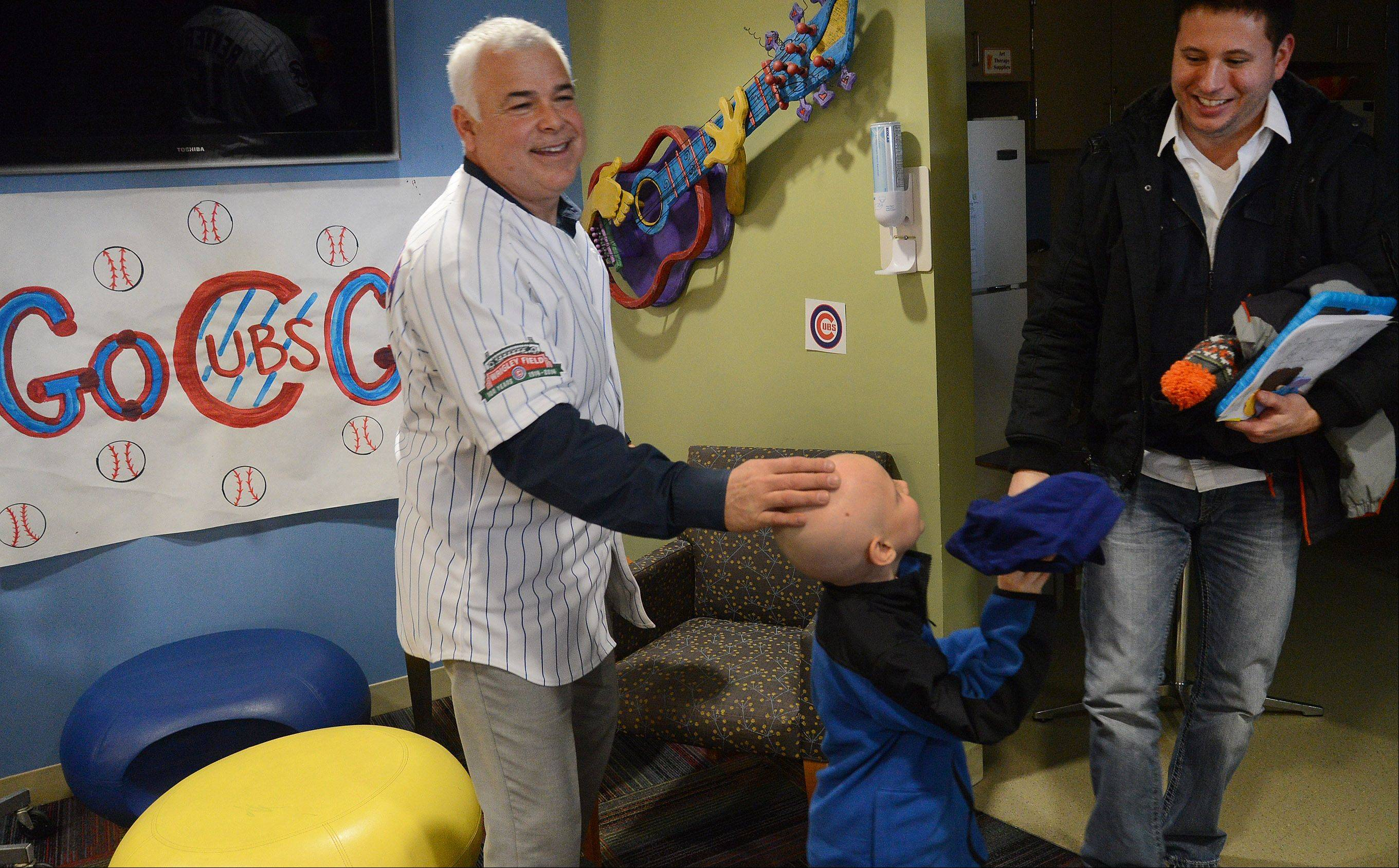 New Cubs manager Rick Renteria autographs a hat for Gavin Fernstrom of East Dundee.