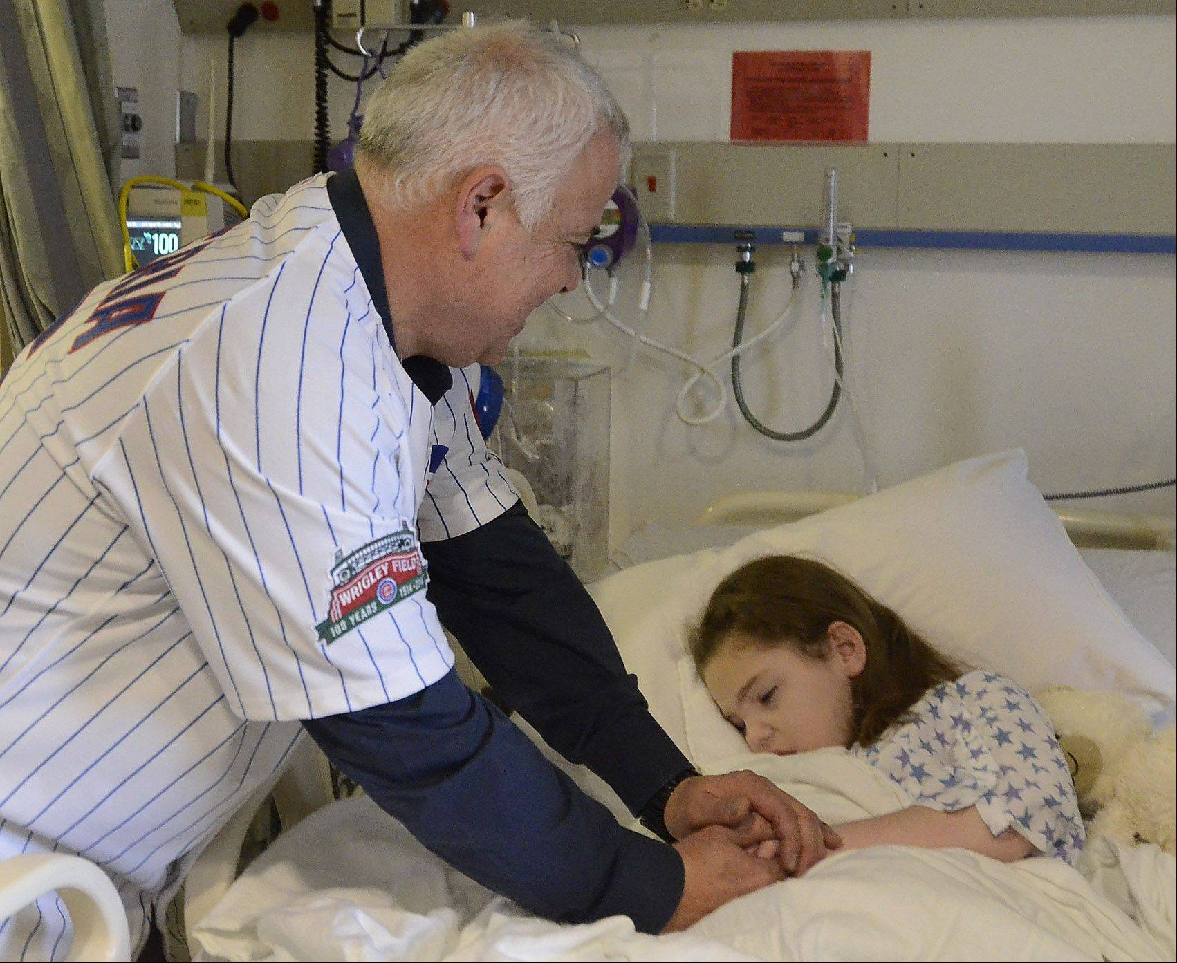 New Cubs manager Rick Renteria spends a quiet moment with Addison Kurtz of Glenview.