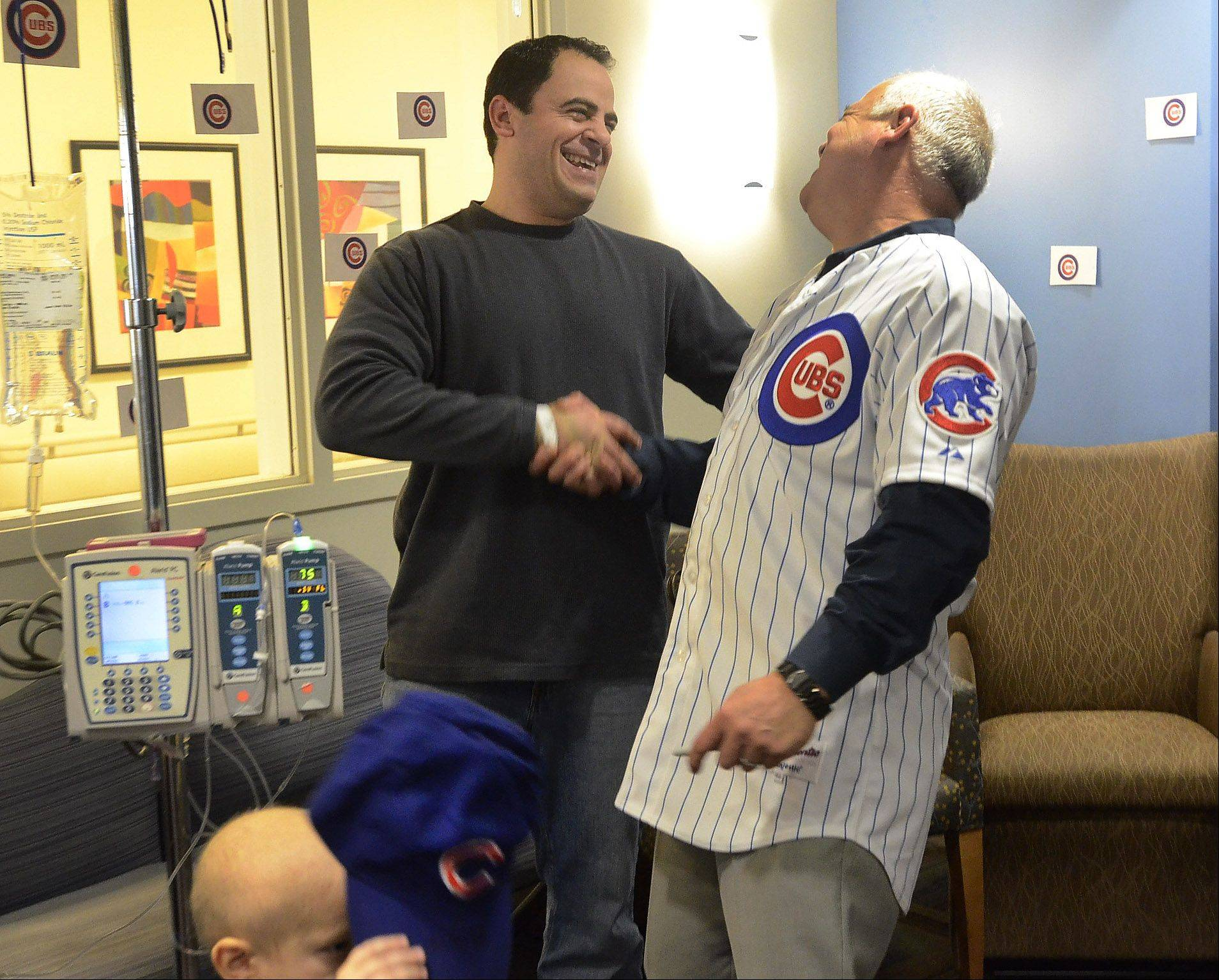 Sergio Filice of Melrose Park, the father of one of the patients, shares a moment with new Cubs manager Rick Renteria.