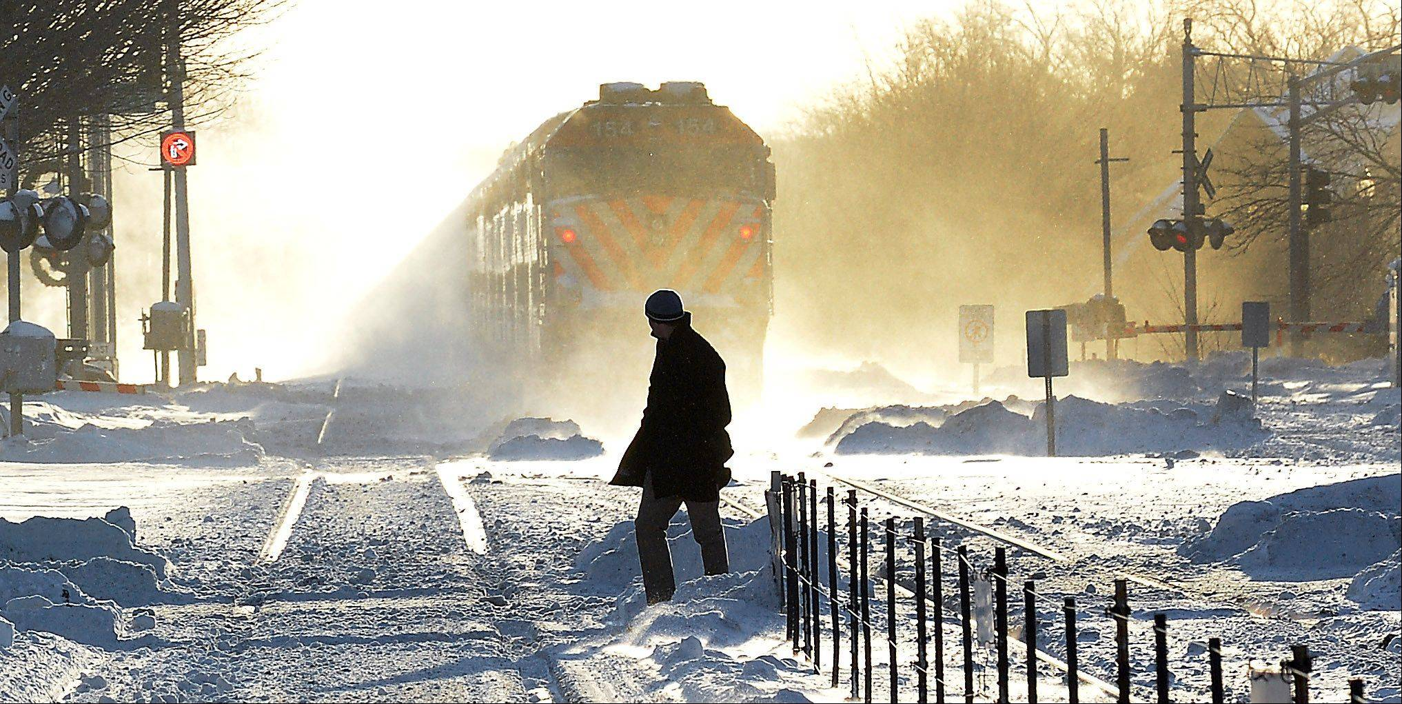 A man man walks to an outbound Metra train at the Arlington Heights station in the sub-freezing temperatures Jan. 6.