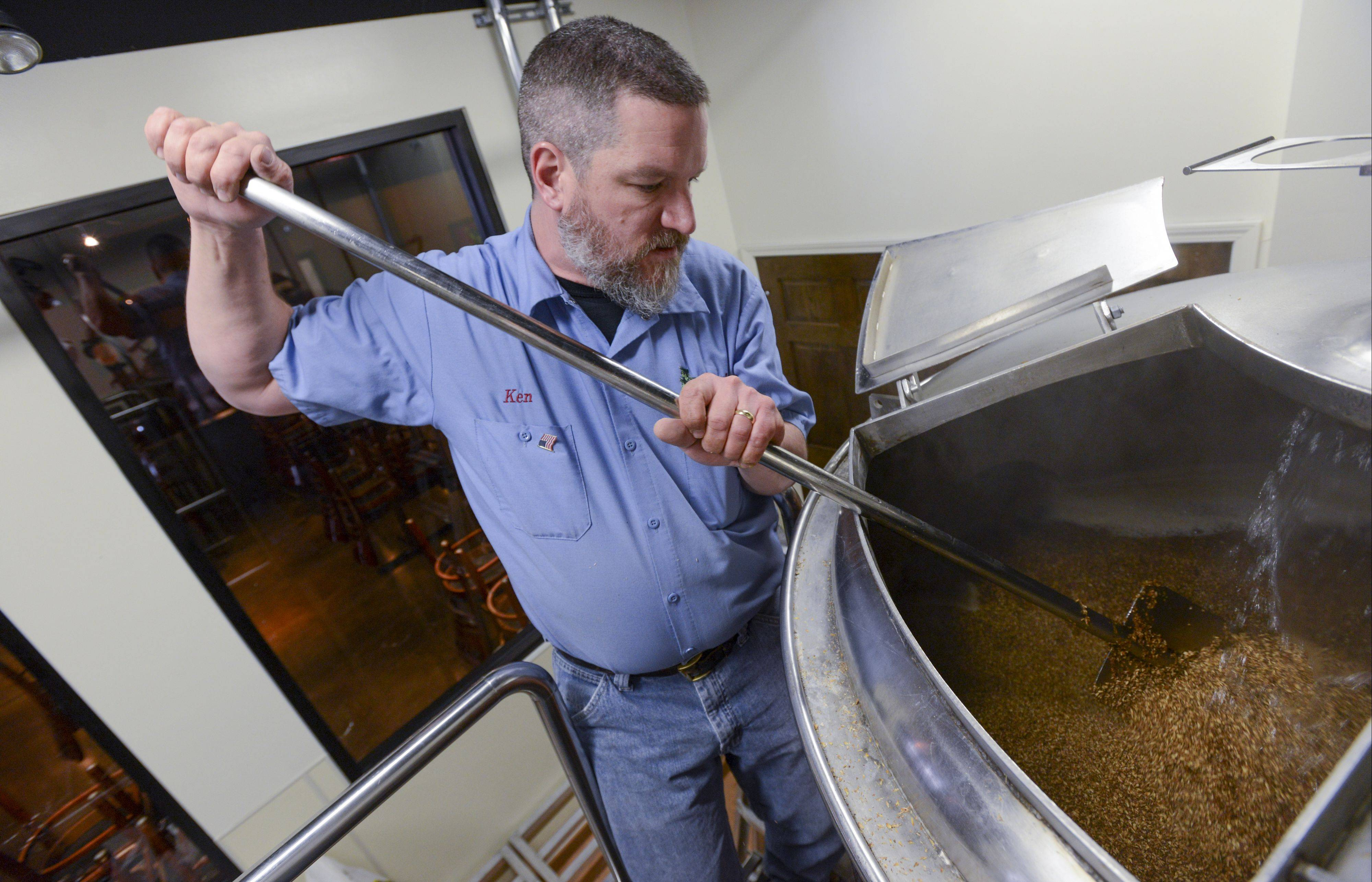Brewmaster Ken McMullen of Naperville stirs the mash as he brews up a batch of IBA, India Brown Ale at the Hopvine Brewing Company in Aurora. During the mash process, various grains are steeped in hot water to extract the fermentable sugars required for fermentation.