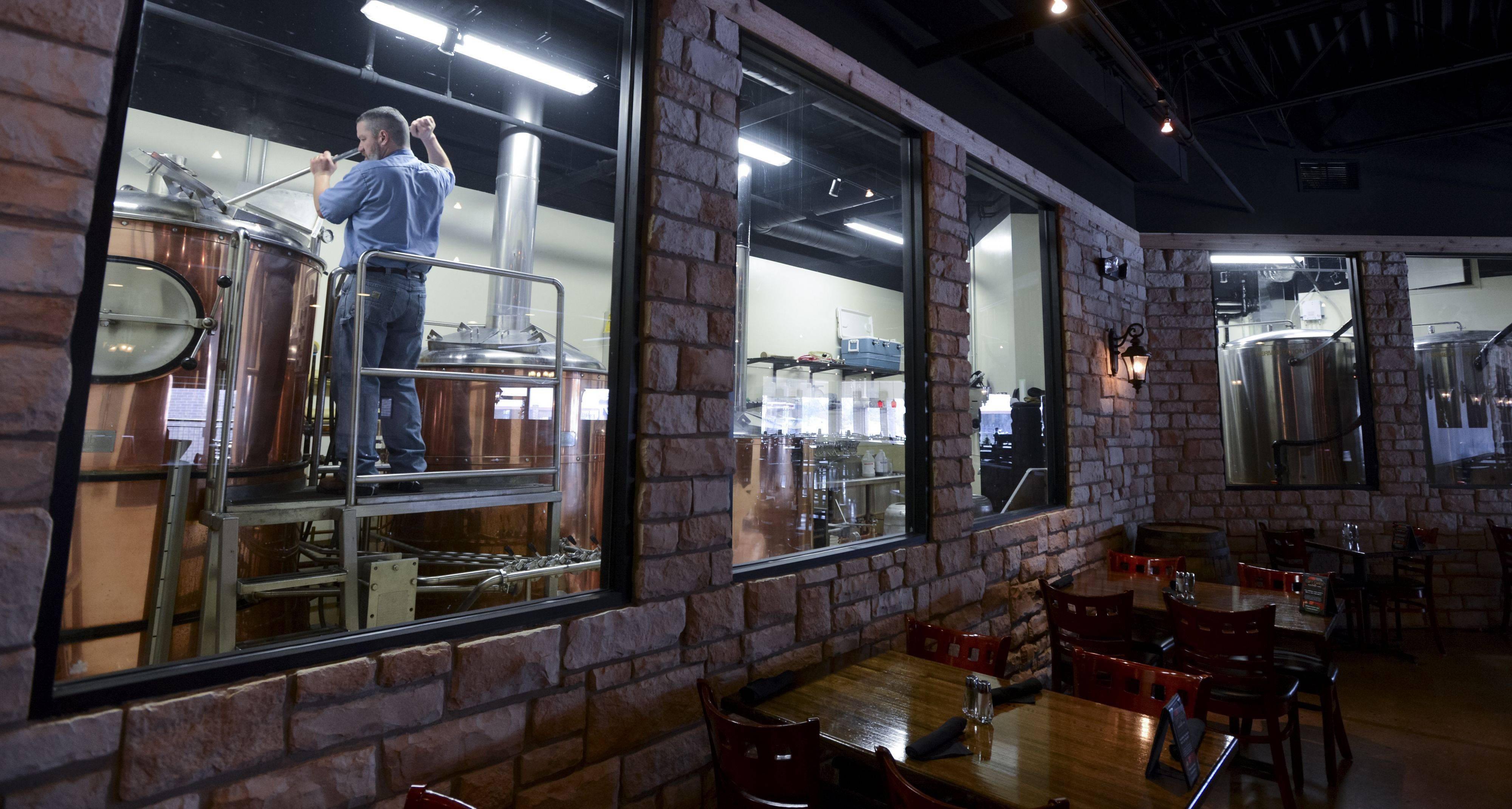 Brewmaster Ken McMullen's brew area is walled with windows so patrons at the Hopvine Brewing Company can see behind the scenes as they dine and enjoy some beers.