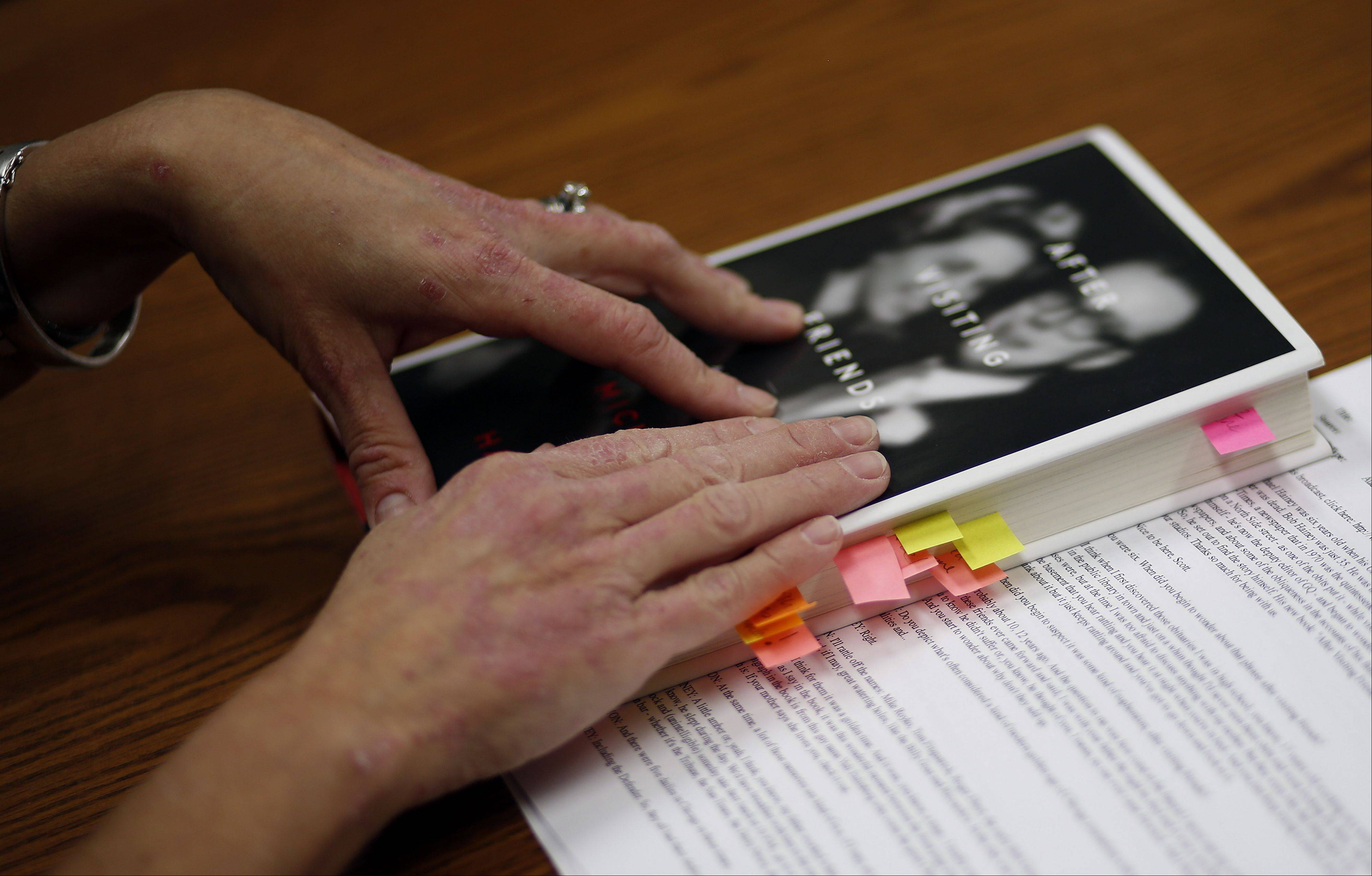 "The book ""After Visiting Friends"" is filled with book marks for discussion during the Second Tuesday Book Discussion Group at the St. Charles Library."