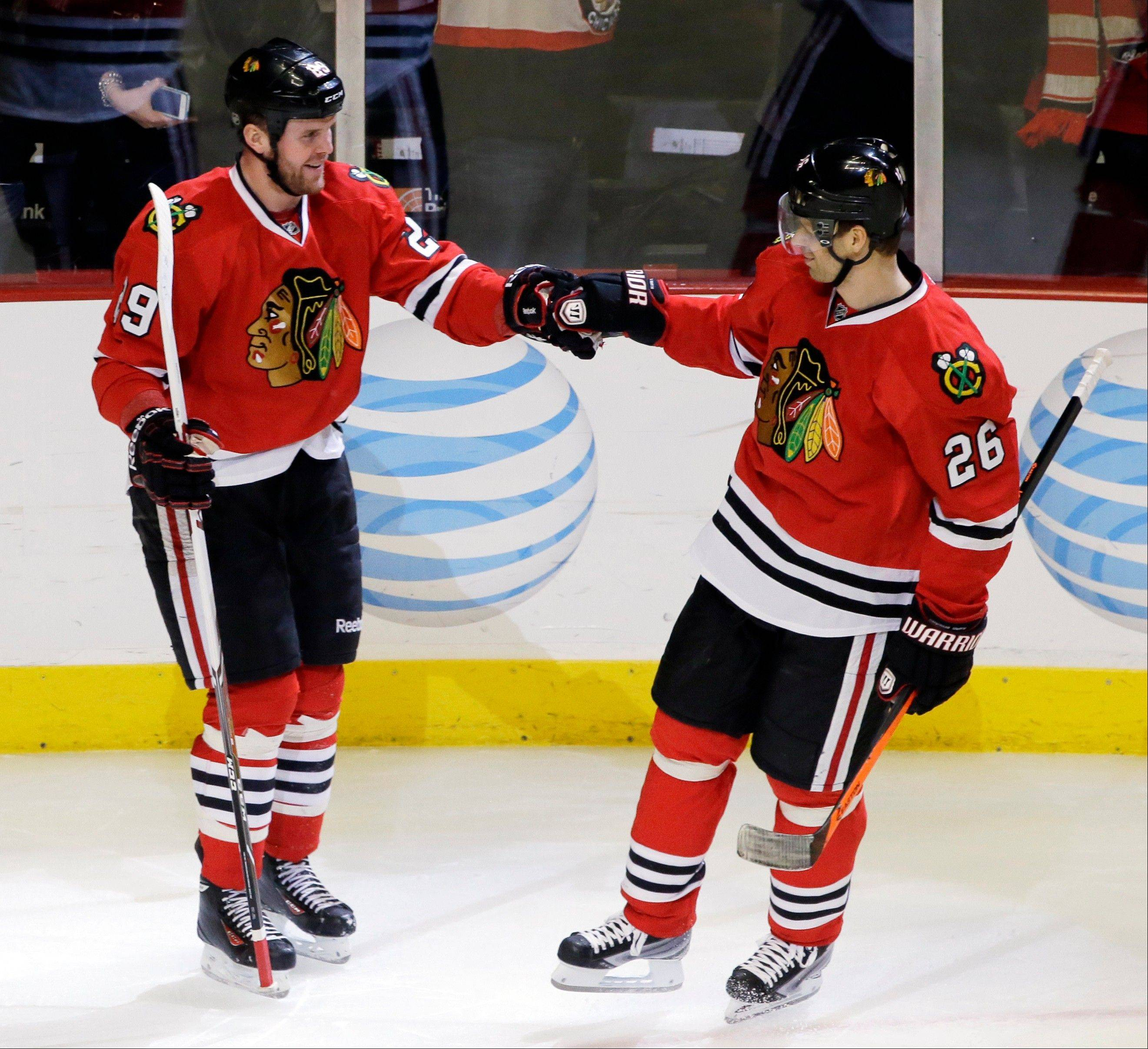 The Blackhawks' Bryan Bickell, left, celebrates with Michal Handzus after scoring against the Ducks in the third period Friday at the United Center.
