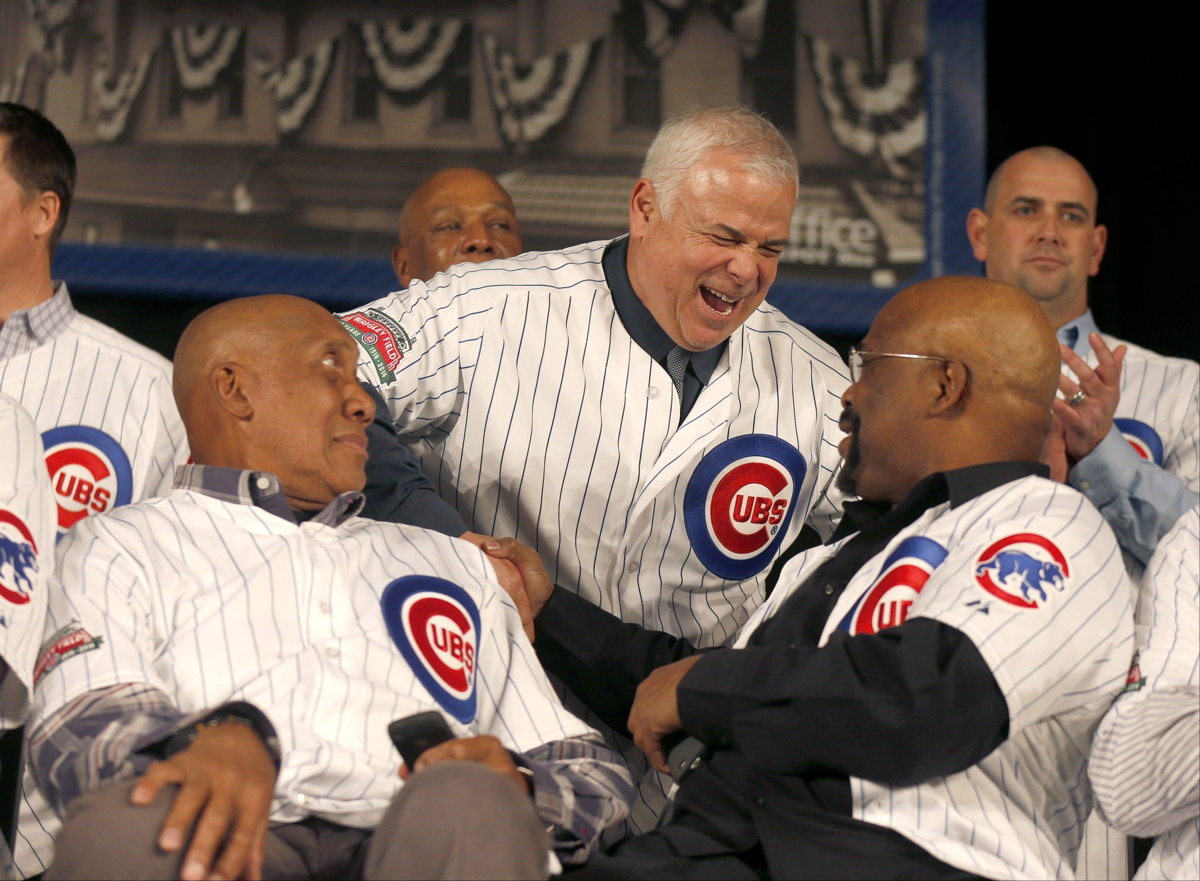 Cubs manager Rick Renteria, center, laughs with former Cub Bill Matlock, right, as Hall of Fame pitcher Ferguson Jenkins watches during the Cubs Convention Friday in Chicago.