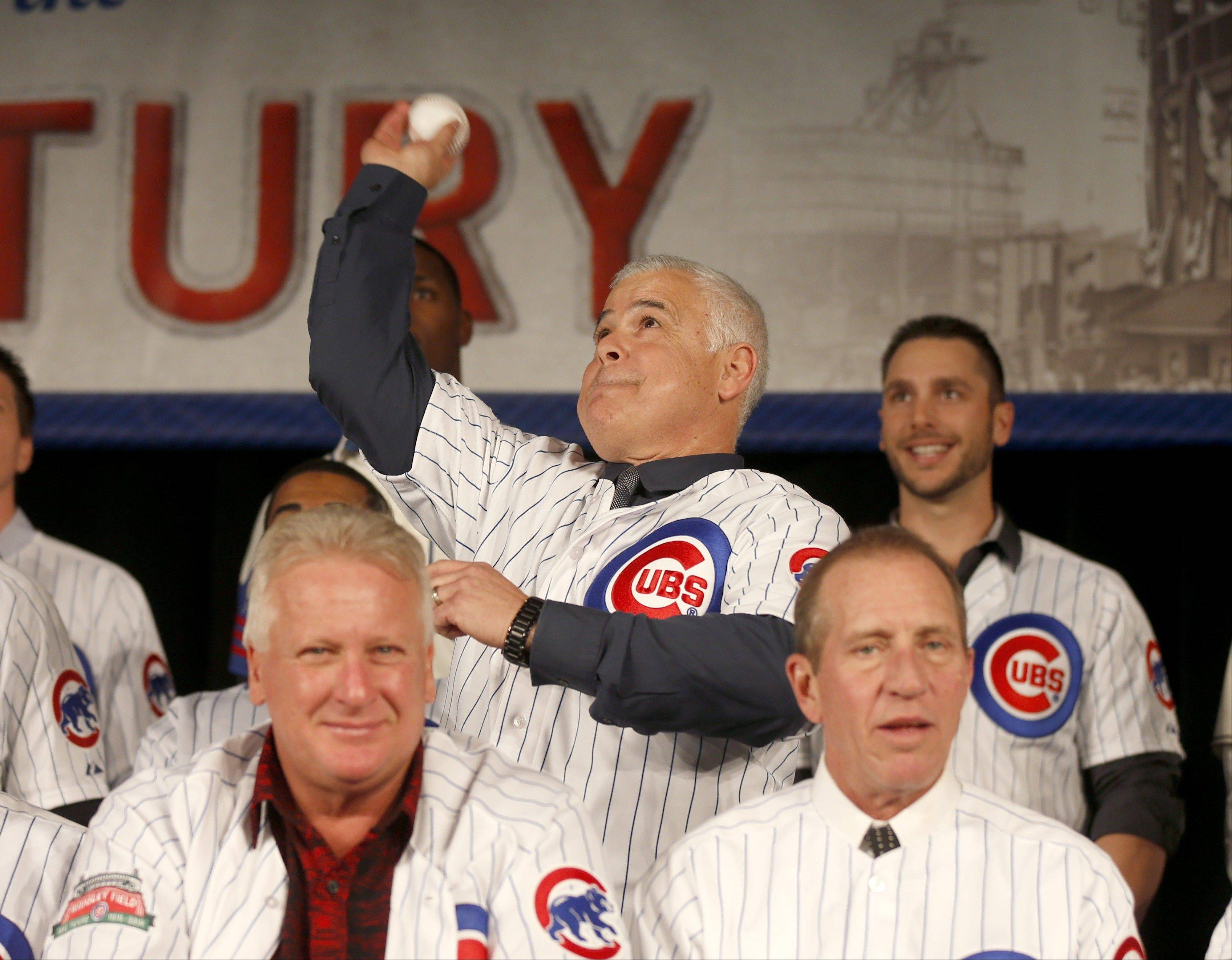 New Cubs manager Rick Renteria throws out a ceremonial first pitch Friday to open the Cubs Convention in Chicago.