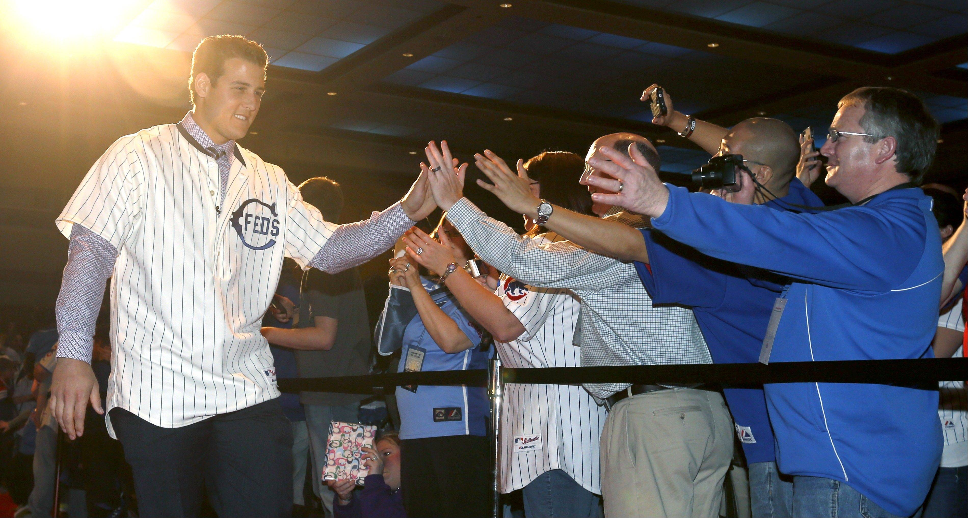 Cubs first baseman Anthony Rizzo greets fans as he is introduced at the Cubs Convention Friday in Chicago.