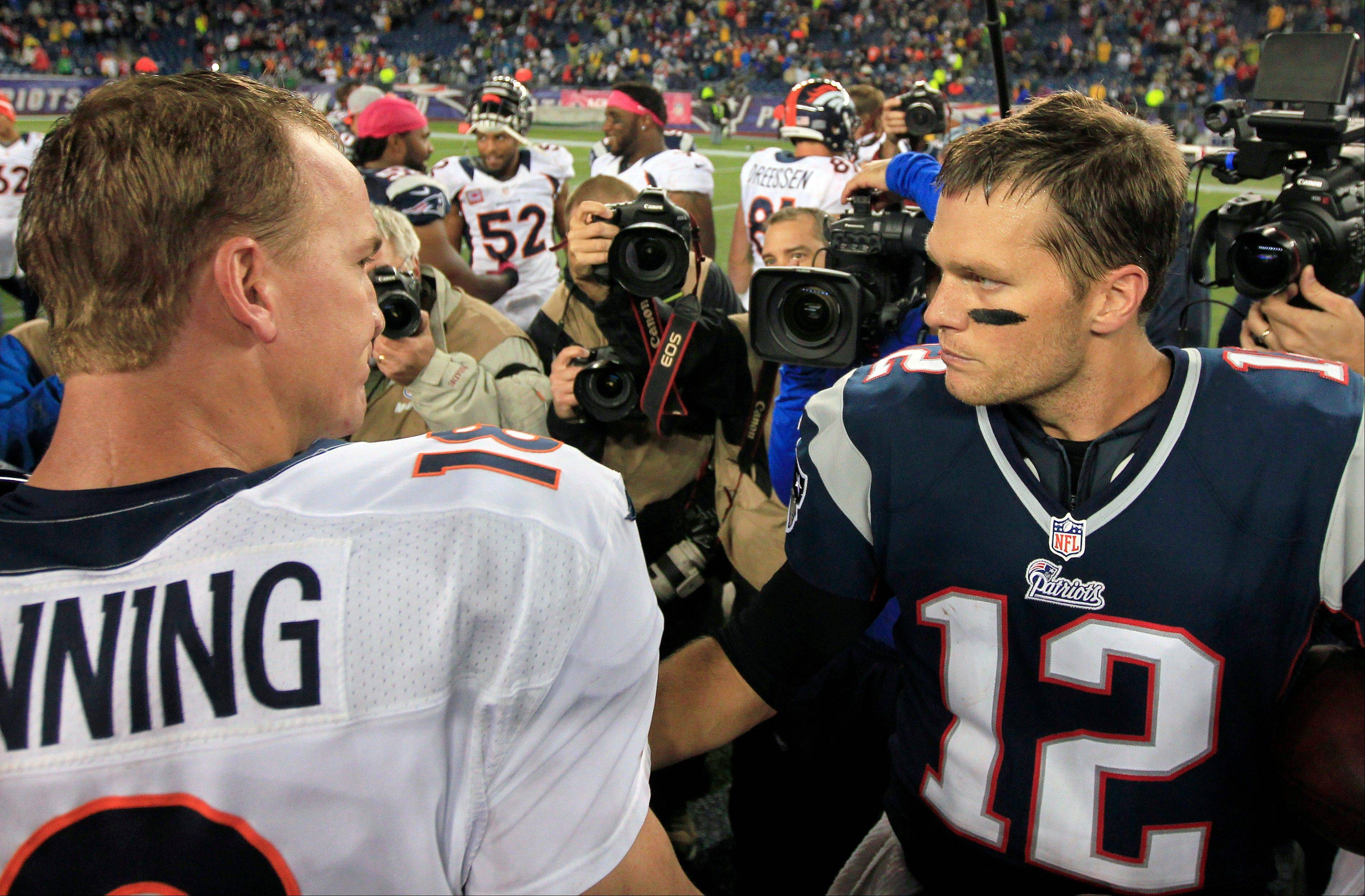 FILE - In this Oct. 7, 2012, file photo, Denver Broncos quarterback Peyton Manning, left, and New England Patriots quarterback Tom Brady, right, speak in the middle of the field after the Patriots beat the Broncos 31-21 in an NFL football game in Foxborough, Mass. The Patriots are scheduled to play the Broncos in the AFC championship game on Sunday in Denver.