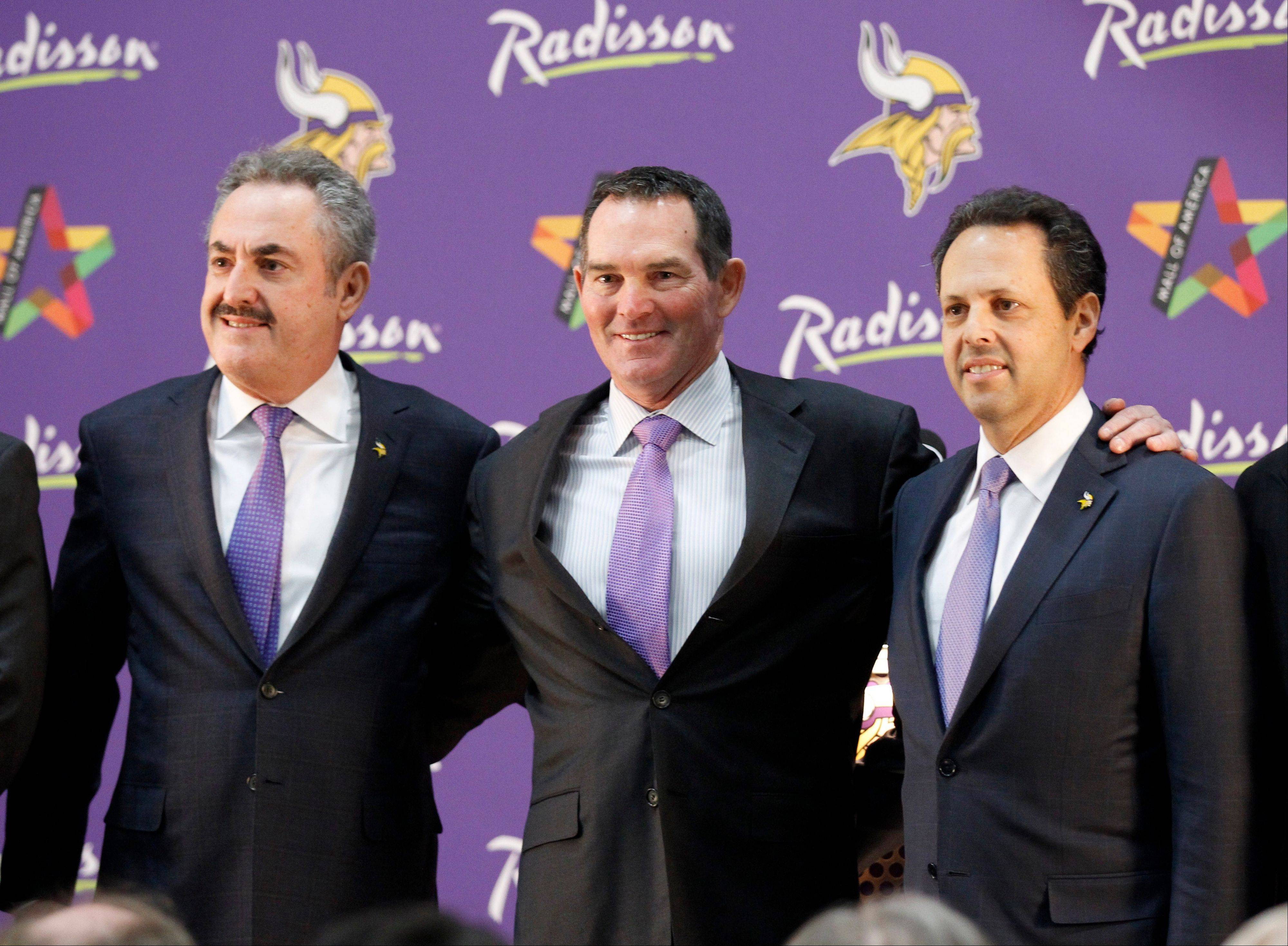 New Minnesota Vikings head coach Mike Zimmer, center, poses with team owner Zygi Wilf, left, and Mark Wilf, right, during an NFL football media availability at Winter Park in Eden Prairie, Minn., Friday, Jan. 17, 2014. Zimmer is the ninth head coach in the Vikings' franchise history.