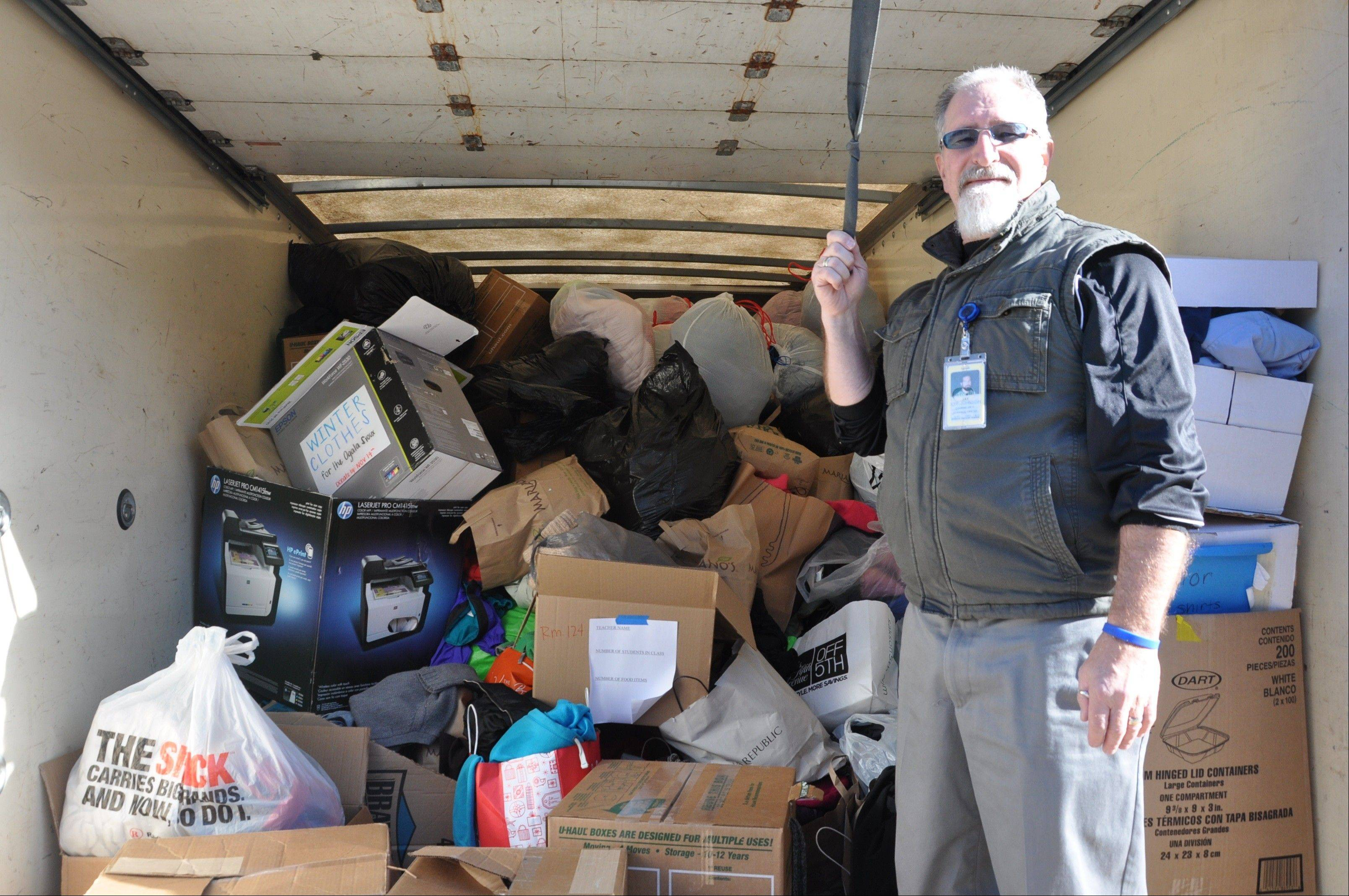 Prospect High School Knights' Way sponsor Jay Kyp-Johnson shows the truckload of donations headed to the Native American reservation in South Dakota.