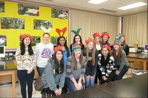 National Honor Society members from Rolling Meadows High School volunteered to wrap presents and make cards for the Be a Santa to a Senior Program.