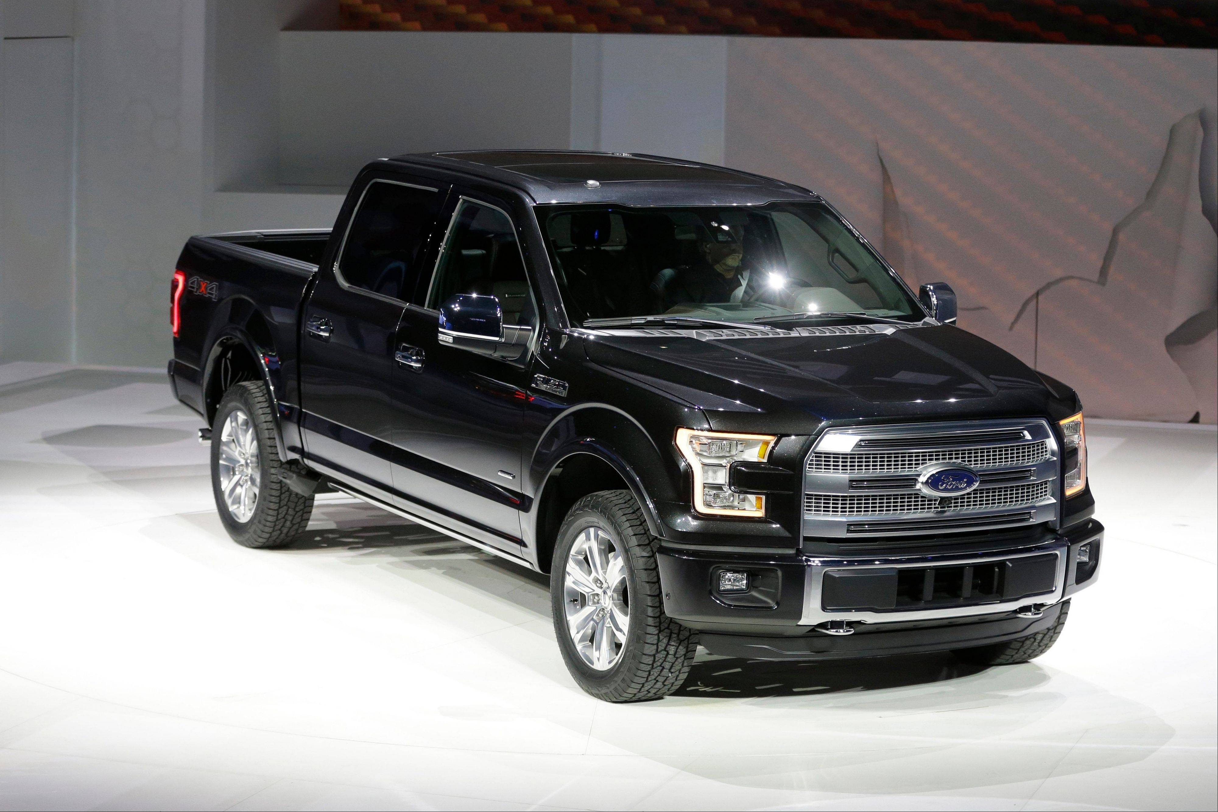 Ford unveils its new F-150 with a body built almost entirely out of aluminum at the North American International Auto Show in Detroit.