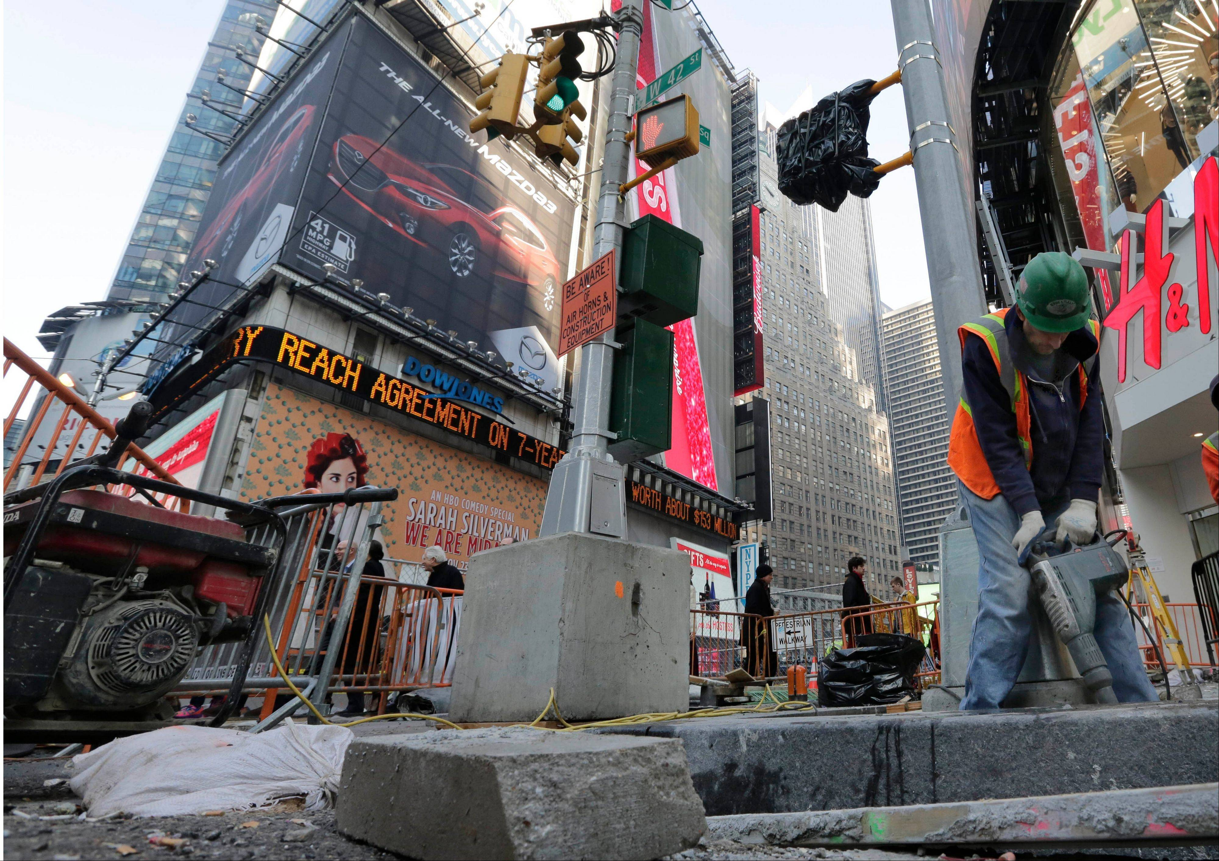 Associated Press/Dec. 4, 2013 A workman uses a generator-powered jackhammer in New York�s Times Square in New York.