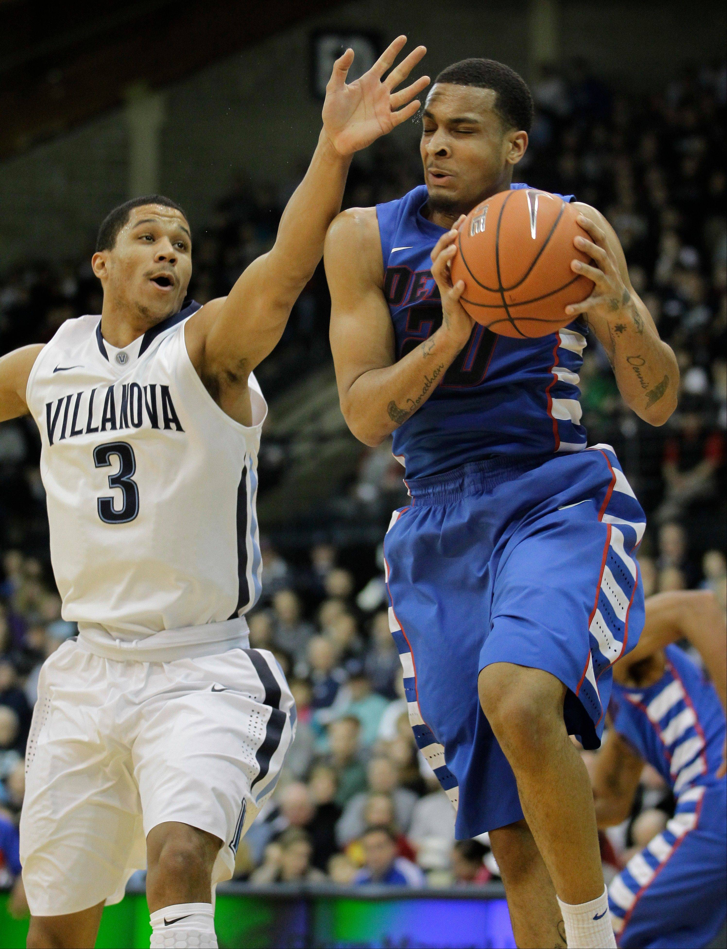 DePaul�s Brandon Young (2) grabs a rebound away from Villanova�s Josh Hart (3) in the first half of an NCAA college basketball game on Saturday in Villanova, Pa.
