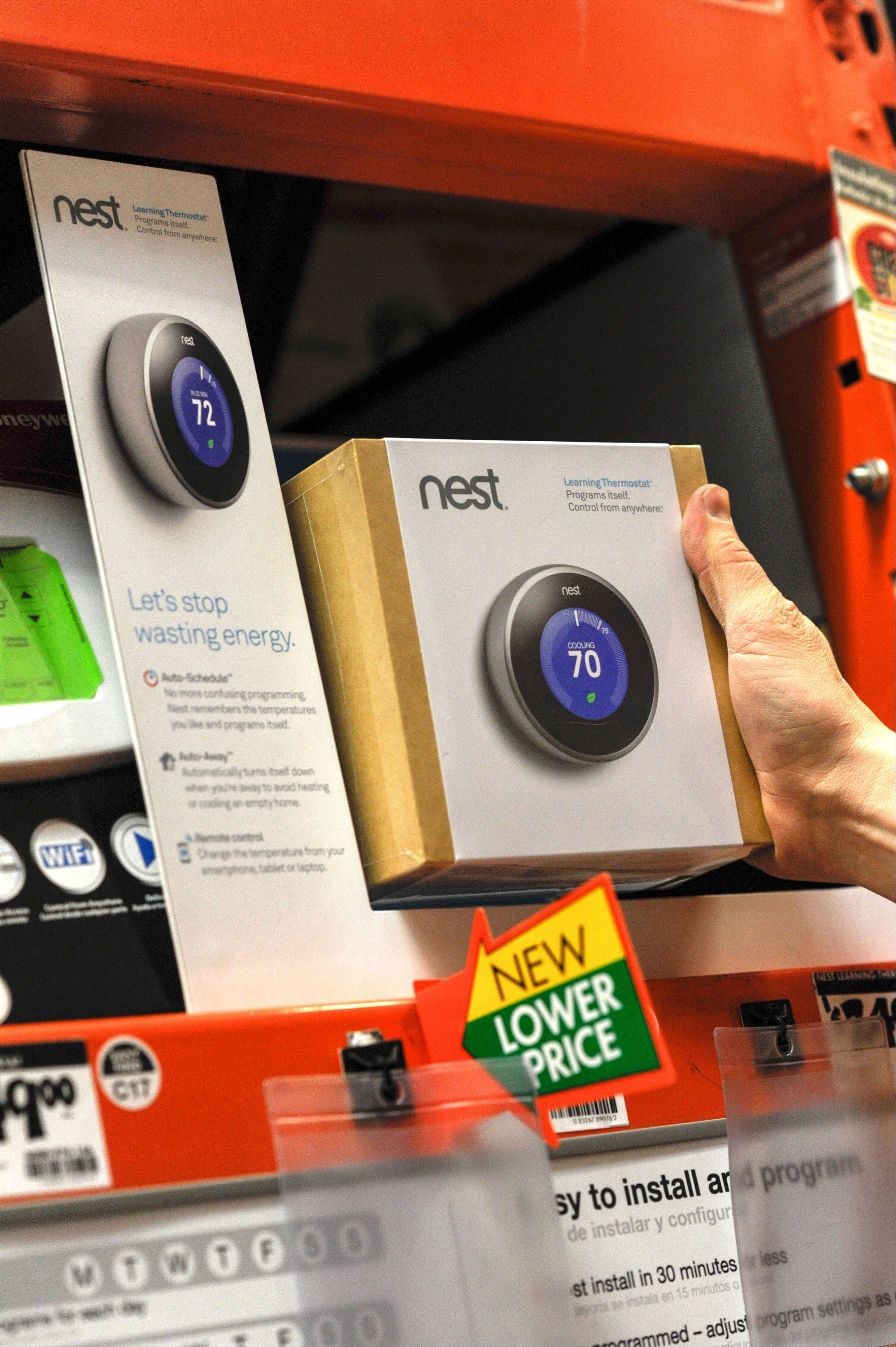 A customer views a Nest Labs Inc. digital thermostat at a Home Depot Inc. store in Emeryville, California, U.S., on Tuesday, Jan. 14, 2014. Google Inc., after struggling to catch Apple Inc. in consumer gadgets, is buying Nest Labs Inc., the digital thermostat maker for $3.2 billion in cash.