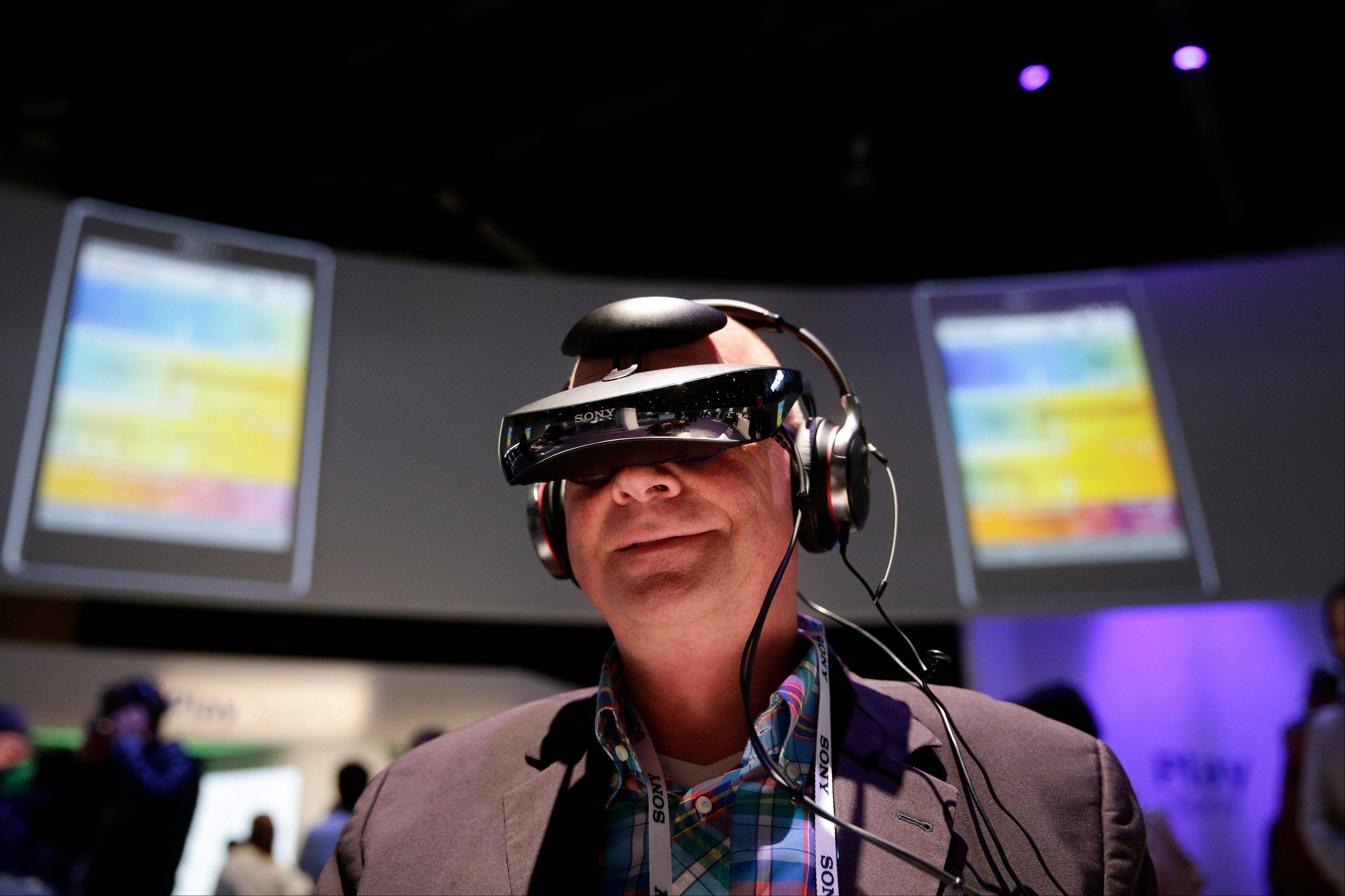 Juergen Boyny, of Germany, watches a video clip with a personal viewing device at the Sony booth at the International Consumer Electronics Show.