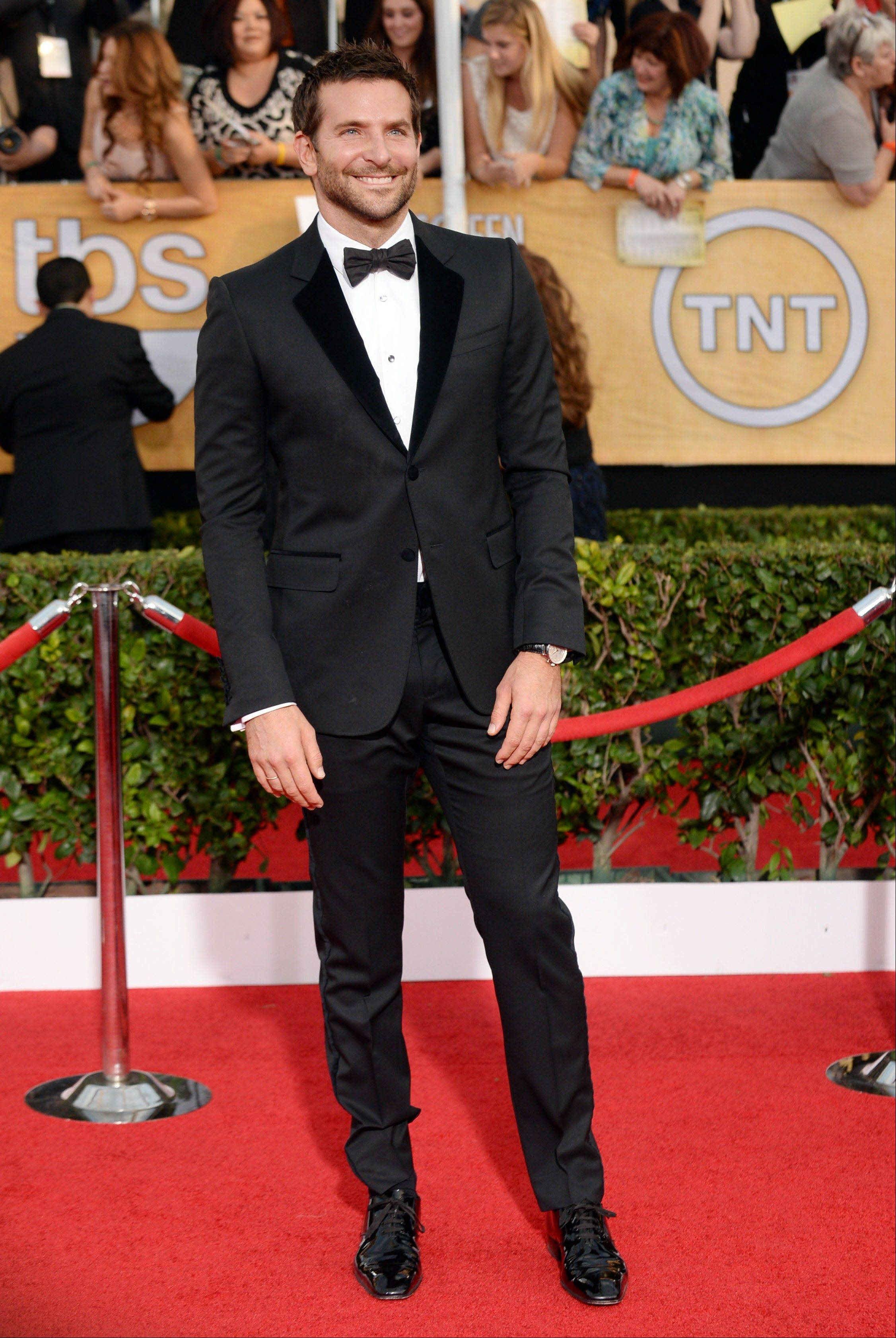 """Amercian Hustle"" star Bradley Cooper arrives at the 20th annual Screen Actors Guild Awards."