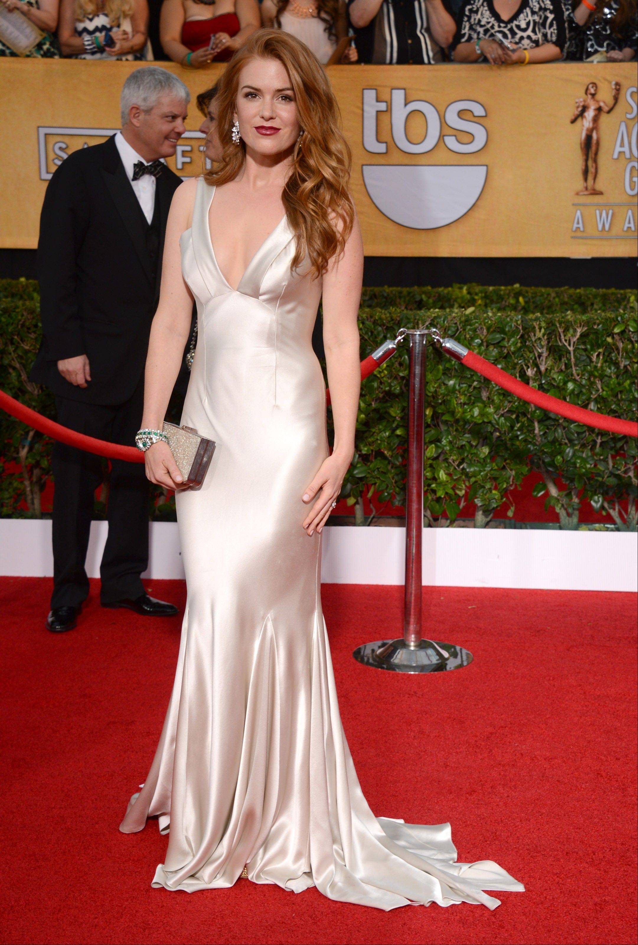 Isla Fisher arrives at the 20th annual Screen Actors Guild Awards.
