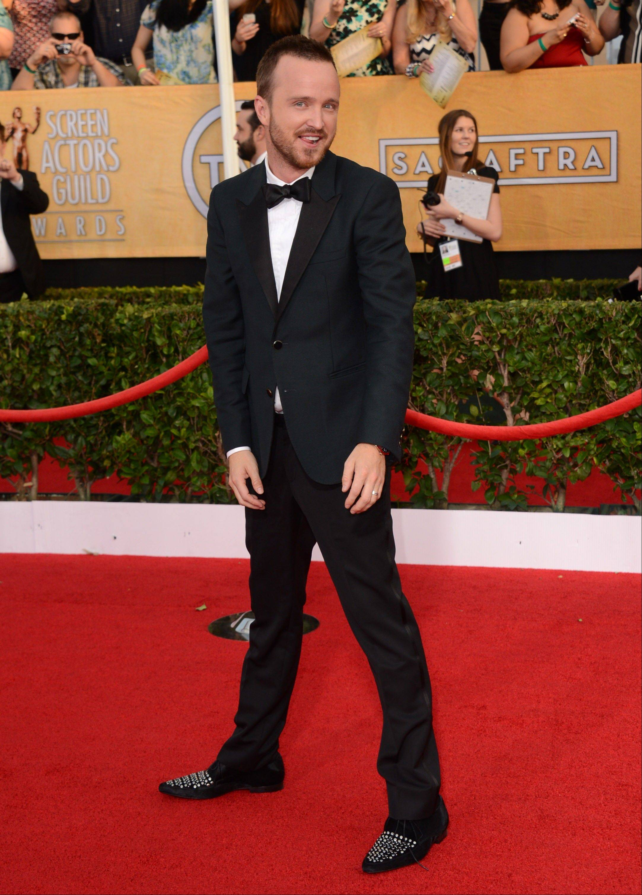 Aaron Paul gets a little playful as he walks the red carpet at the SAG Awards.