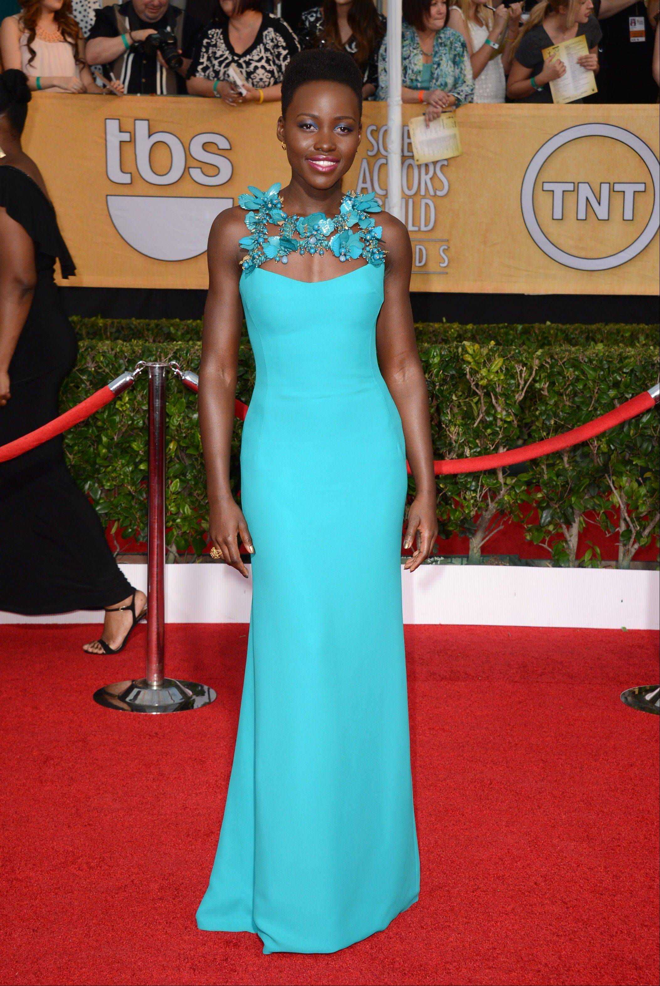 Lupita Nyong'o arrives at the 20th annual Screen Actors Guild Awards.