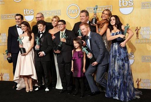 "The cast of ""Modern Family"" shows off their award for outstanding performance by an ensemble in a comedy series."