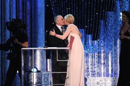 "Robert DeNiro gives Cate Blanchett a smooch after presenting her with an award for her role in ""Blue Jasmine."""