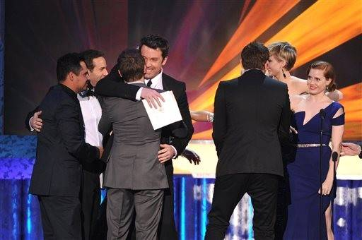 "Ben Affleck presents the ensemble award to the cast of ""American Hustle"""