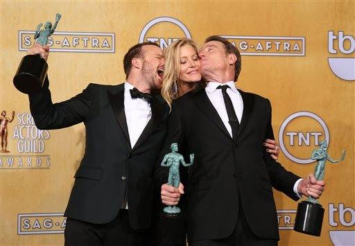 "Aaron Paul, Anna Gun and Bryan Cranston get a little rowdy back stage after their win for ""Breaking Bad."""