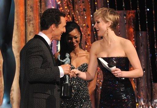 "Jennifer Lawrence presents the actor to Matthew McConaughey for his role in ""Dallas Buyers Club."""