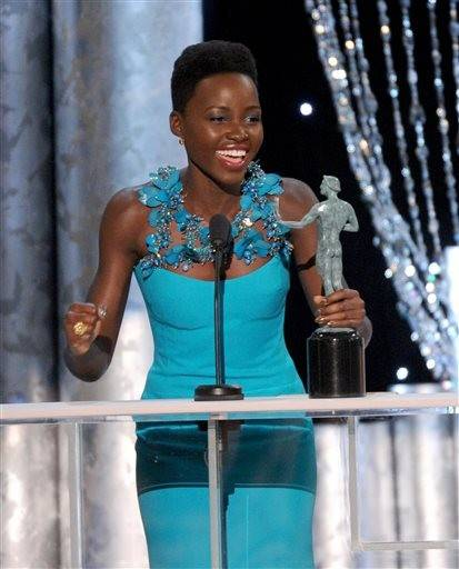 "Lupita Nyong'o accepts the actor for her role in ""12 Years a Slave."""