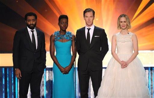 From left, Chiwetel Ejiofor, Lupita Nyong'o, Benedict Cumberbatch and Sarah Paulson speak on stage at the 20th annual Screen Actors Guild Awards at the Shrine Auditorium on Saturday, Jan. 18, 2014, in Los Angeles.