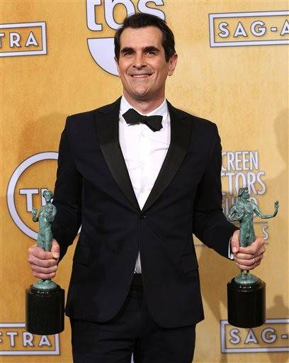 "Ty Burell holds his two SAG Awards for ensemble and best actor for his role on ""Modern Family."""