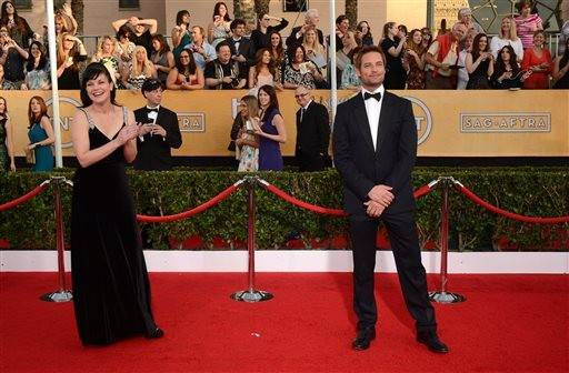 Pauley Perrette and Josh Holloway, who would later present with one another during the ceremony, make their way down the red carpet.