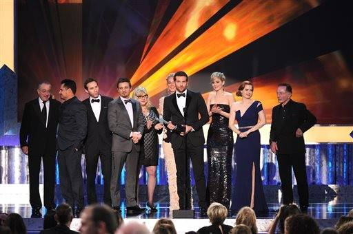 "From left, Robert De Niro, Michael Pena, Alessandro Nivola, Jeremy Renner, Colleen Camp, Elisabeth Rohm, Bradley Cooper, Jennifer Lawrence, Amy Adams and Paul Herman accept the award for outstanding performance by a cast in a motion picture for ""American�Hustle"" at the 20th annual Screen Actors Guild Awards at the Shrine Auditorium on Saturday."