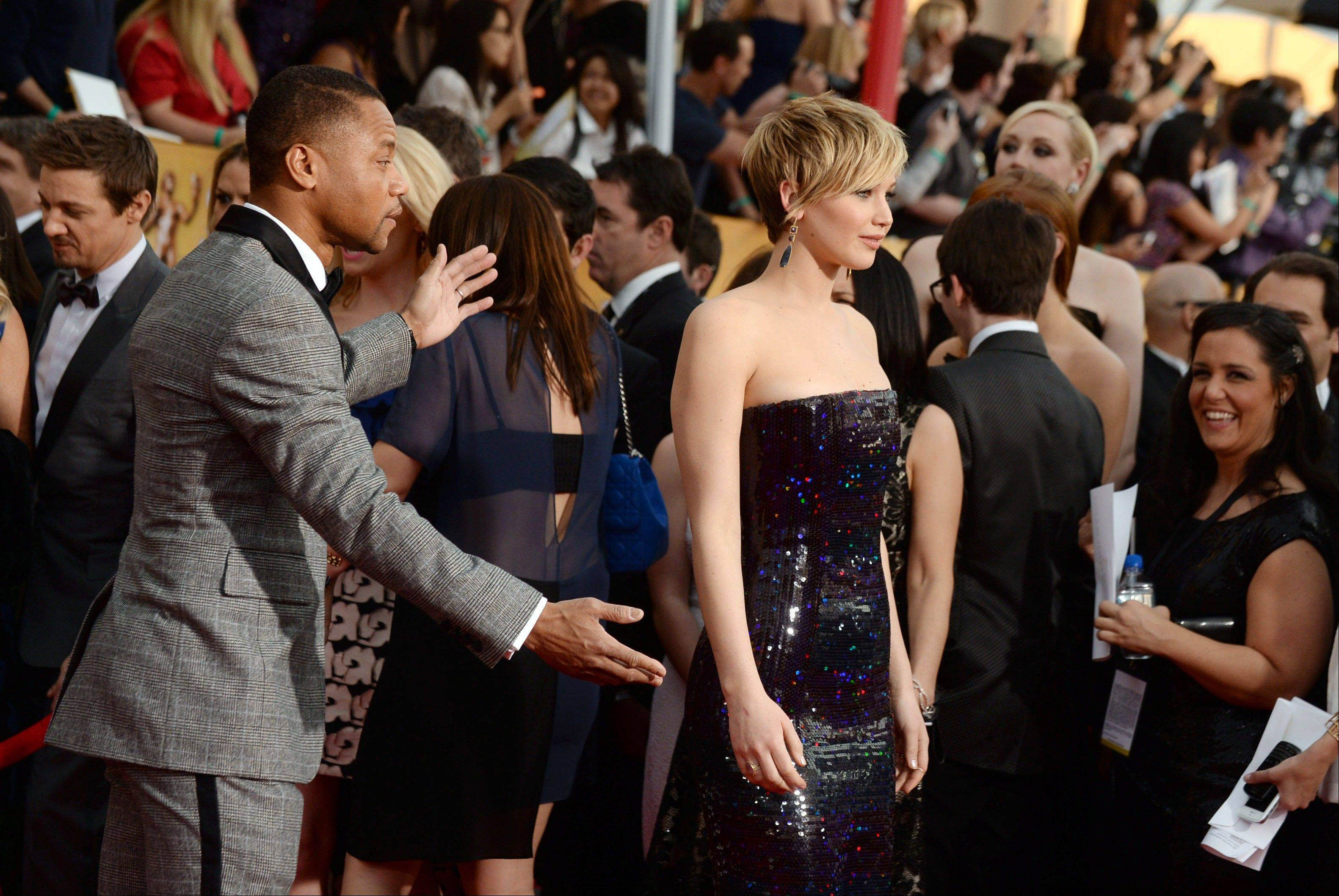 Cuba Gooding Jr., left, and Jennifer Lawrence make their way down the press line at the 20th annual Screen Actors Guild Awards.