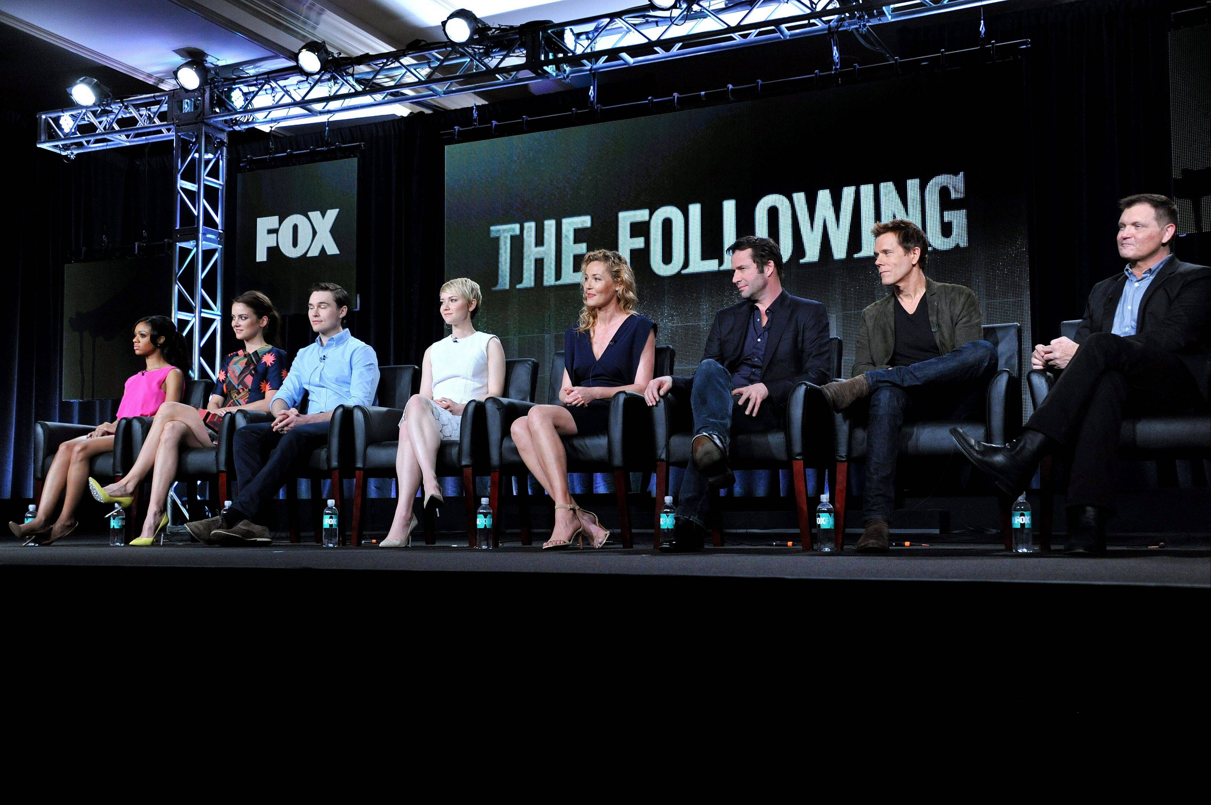 "Tiffany Boone, from left, Jessica Stroup, Sam Underwood, Valorie Curry, Connie Nielson, James Purefoy, Kevin Bacon and creator Kevin Williamson are seen during the panel for ""The Following"" at the FOX Winter 2014 TCA Monday at the Langham Hotel in Pasadena, Calif."