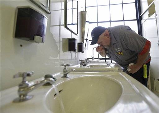 Al Jones of the West Virginia department of General Services tests the water as he flushes the faucet and opens a rest room on the first floor of the State Capitol in Charleston, W.Va., The chemical spill that contaminated water for hundreds of thousands of West Virginians is just the latest and most high-profile case of coal polluting the nation's waters. An Associated Press analysis of federal environmental data found chemicals and waste from the coal industry have tainted hundreds of waterways and groundwater supplies for decades, spoiling private wells, shutting down fishing and rendering streams virtually lifeless.