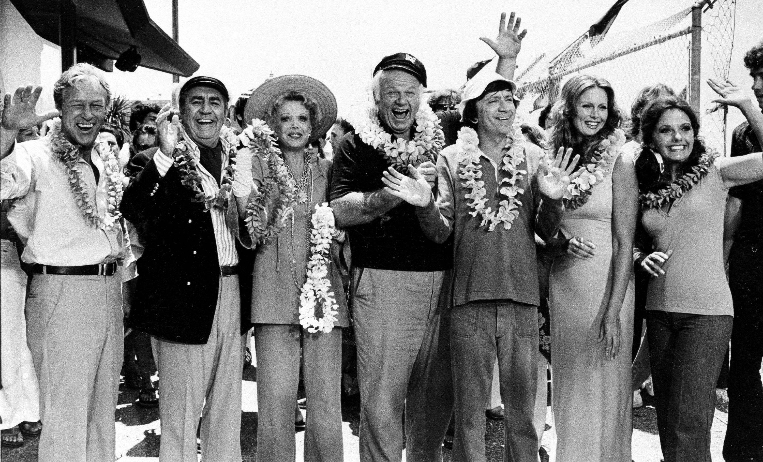 "The cast of ""Gilligan's Island,"" from left, Russell Johnson, as the professor; Jim Backus as Thurston Howell III; Natalie Schafer, as Mrs. Howell III; Alan Hale Jr., as the skipper; Bob Denver, as Gilligan; Judith Baldwin replacing original cast member Tina Louise, as Ginger, and Dawn Wells, as Mary Ann, posing during filming of a two-hour reunion show, ""The Return from Gilligan's Island,"" in Los Angeles."