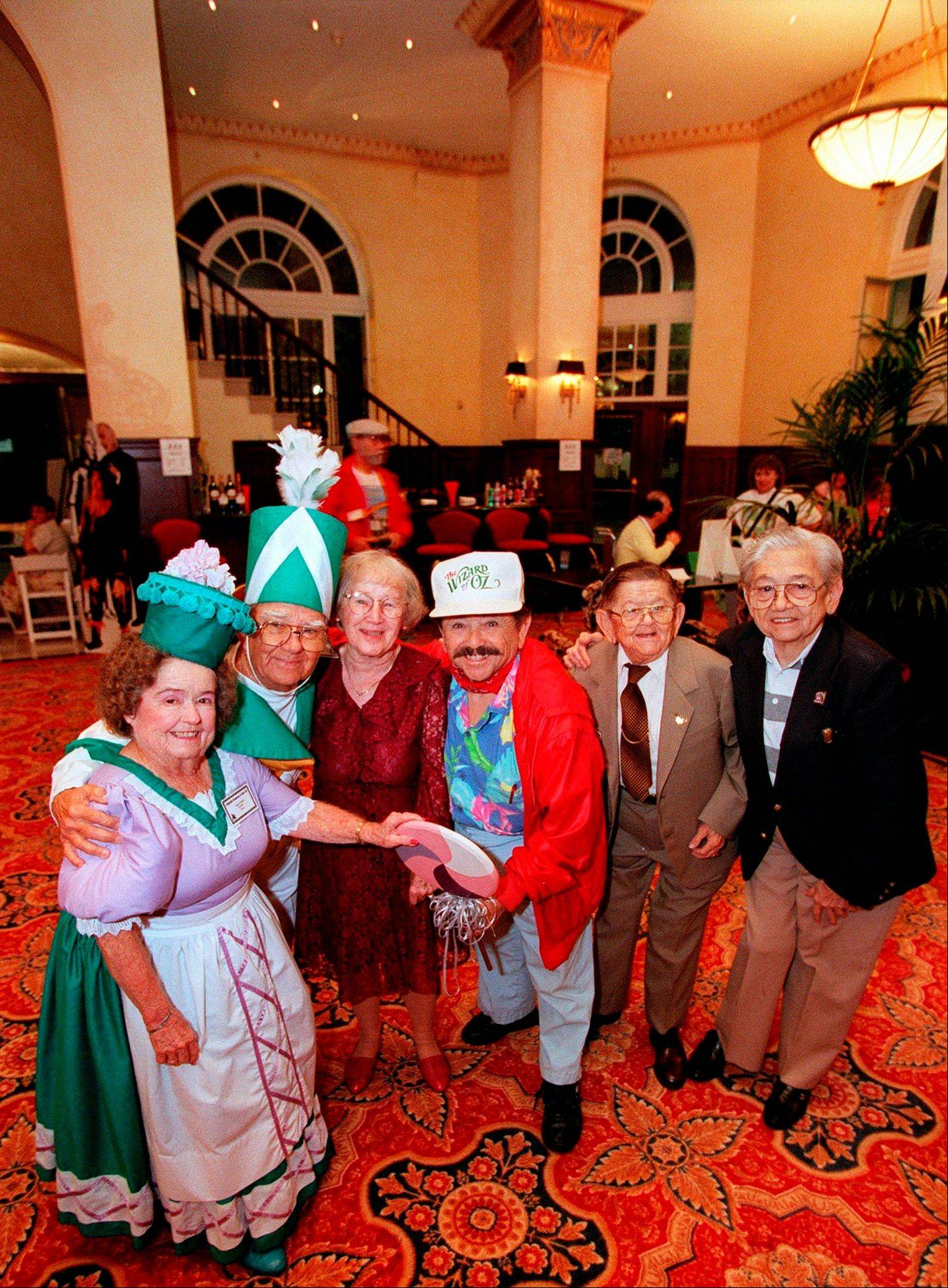"Cast members of the Munchkins from ""The Wizard of Oz,"" from left, Margaret Pellegrini, Clarence Swensen, Ruth Duccini, Jerry Maren, Karl Slover, and Mickey Carroll."