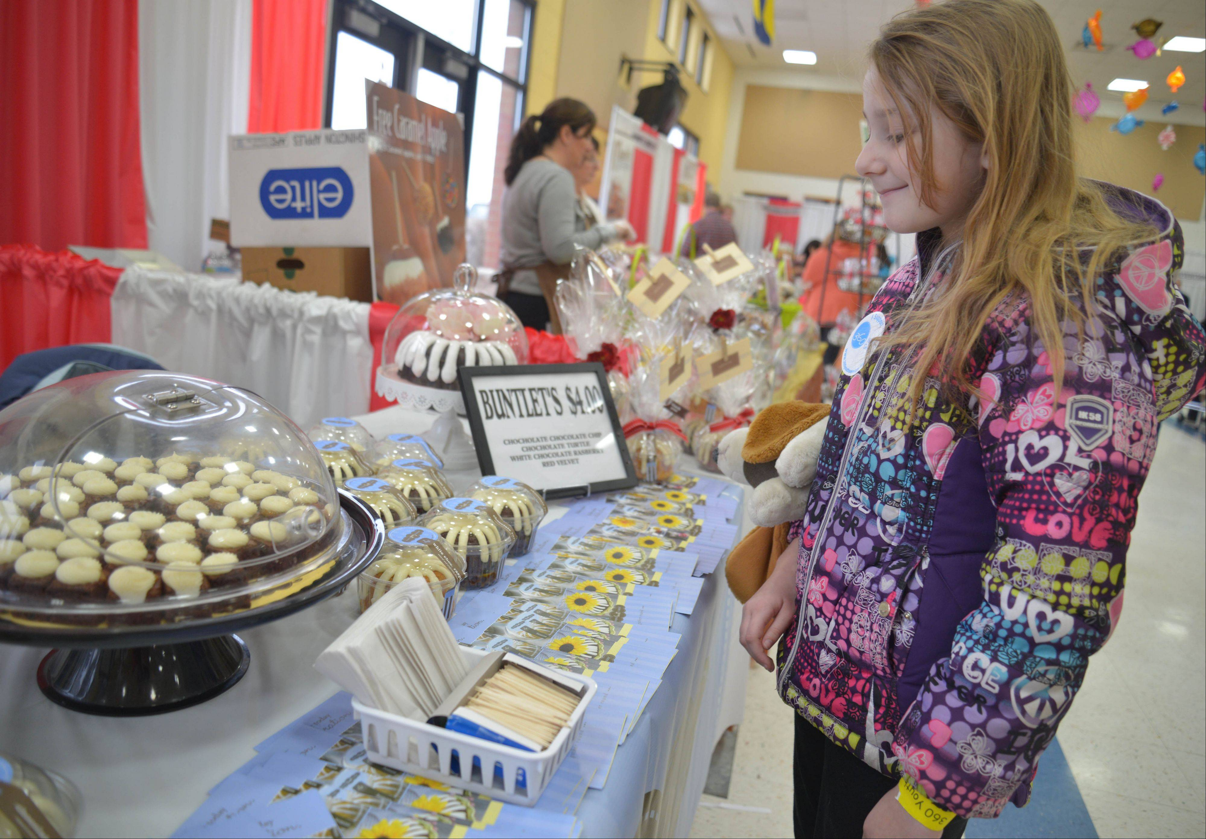 Abby Waitekus, 10, of Yorkville looks for something to snack on at the 360 Youth Services 11th annual Chocolate Festival Saturday at the Neuqua Valley Freshman Center.