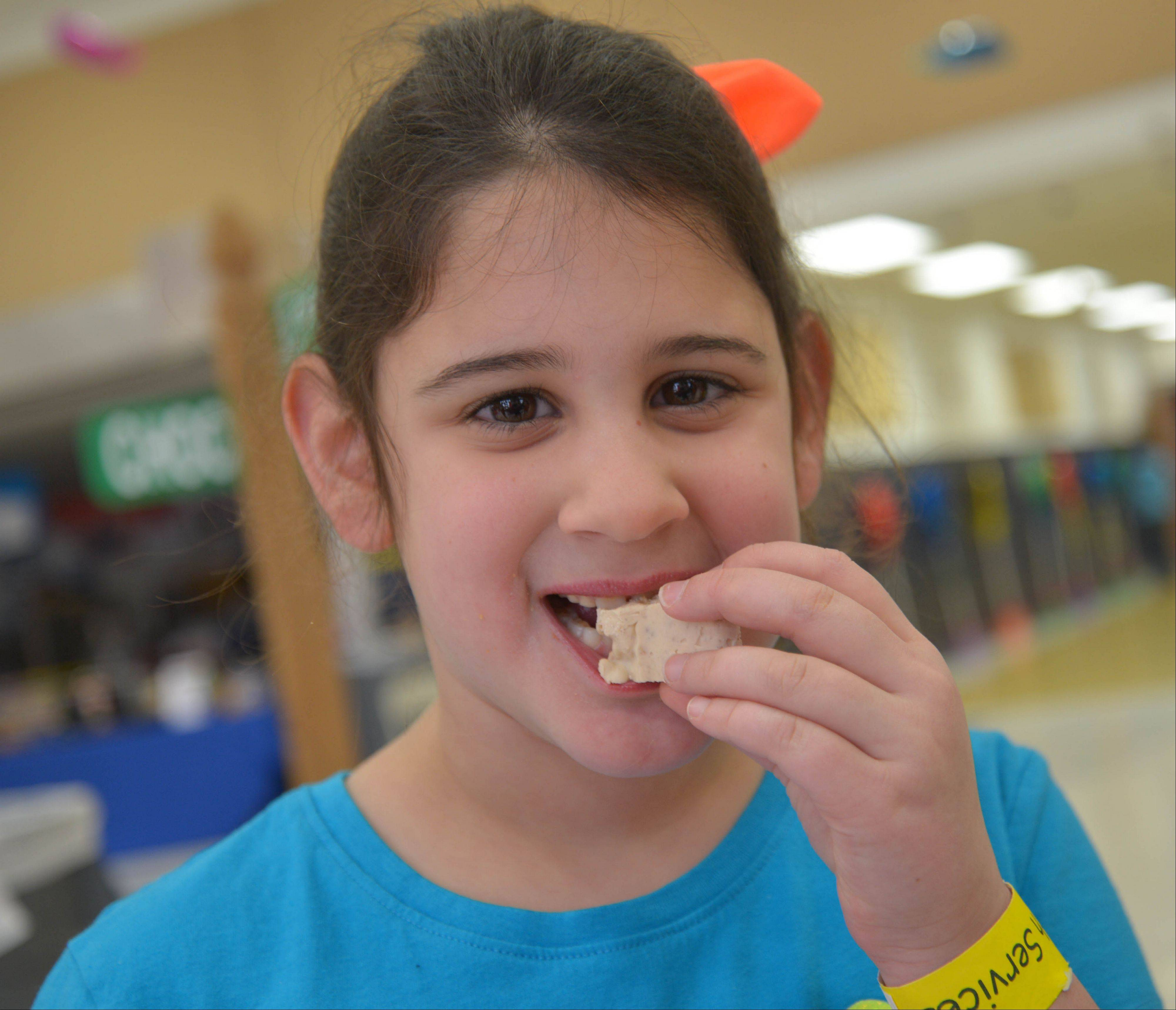 Grace Pantano, 6, of Naperville tastes some chocolate during the 360 Youth Services 11th annual Chocolate Festival Saturday at the Neuqua Valley Freshman Center in Naperville.